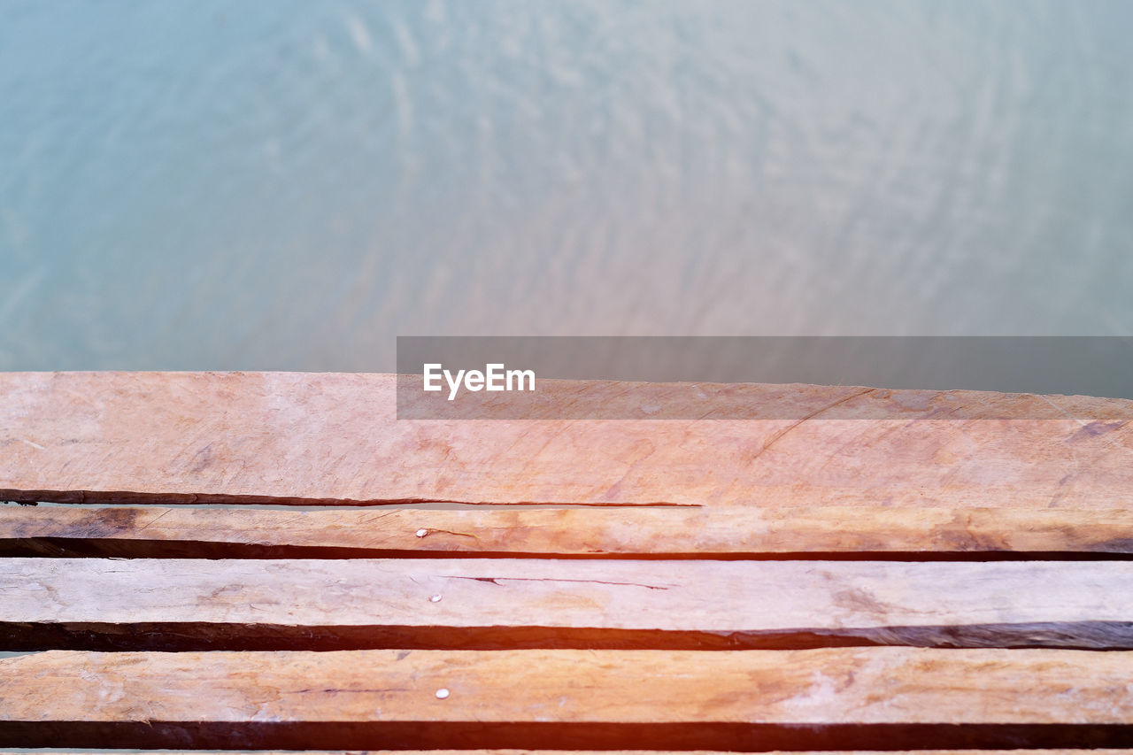 water, no people, day, wood - material, close-up, nature, lake, outdoors, pattern, high angle view, sunlight, metal, full frame, architecture, railing, brown, built structure, backgrounds, textured
