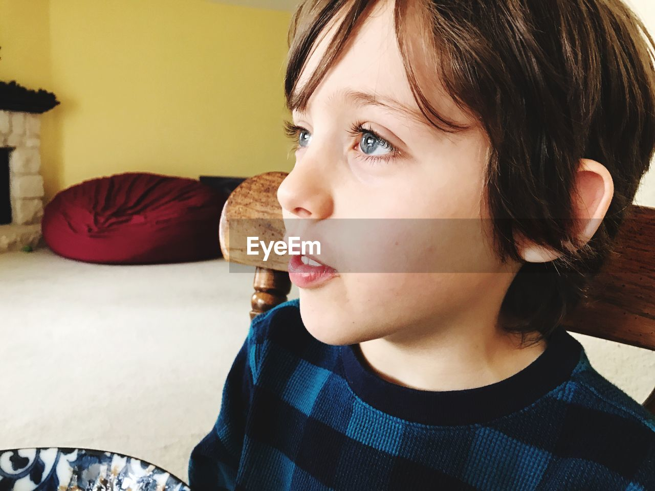 one person, indoors, real people, headshot, home interior, childhood, sitting, boys, close-up, young adult, day, people
