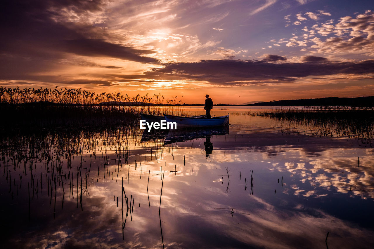 sky, sunset, cloud - sky, water, reflection, nautical vessel, scenics - nature, beauty in nature, mode of transportation, orange color, transportation, tranquility, tranquil scene, lake, nature, idyllic, non-urban scene, waterfront, real people