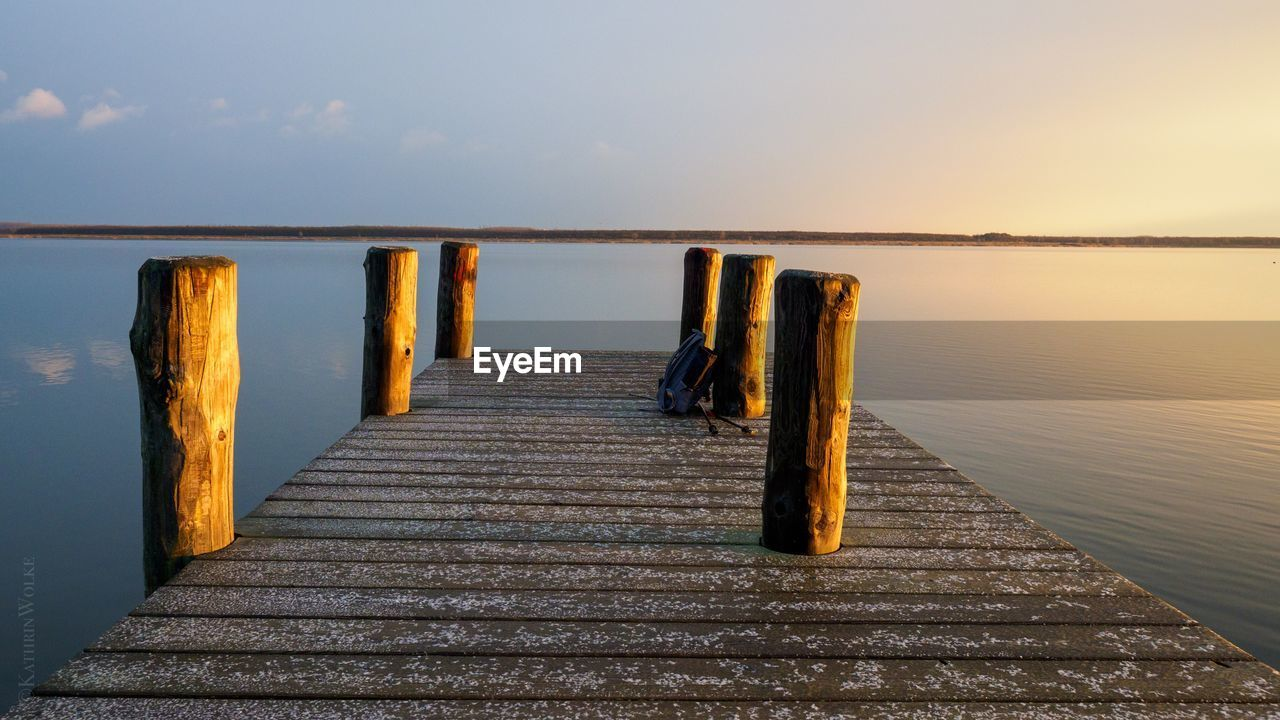 water, sky, wood - material, tranquility, tranquil scene, pier, beauty in nature, no people, sea, the way forward, nature, scenics - nature, direction, horizon, post, jetty, railing, horizon over water, wooden post, outdoors, wood paneling, long