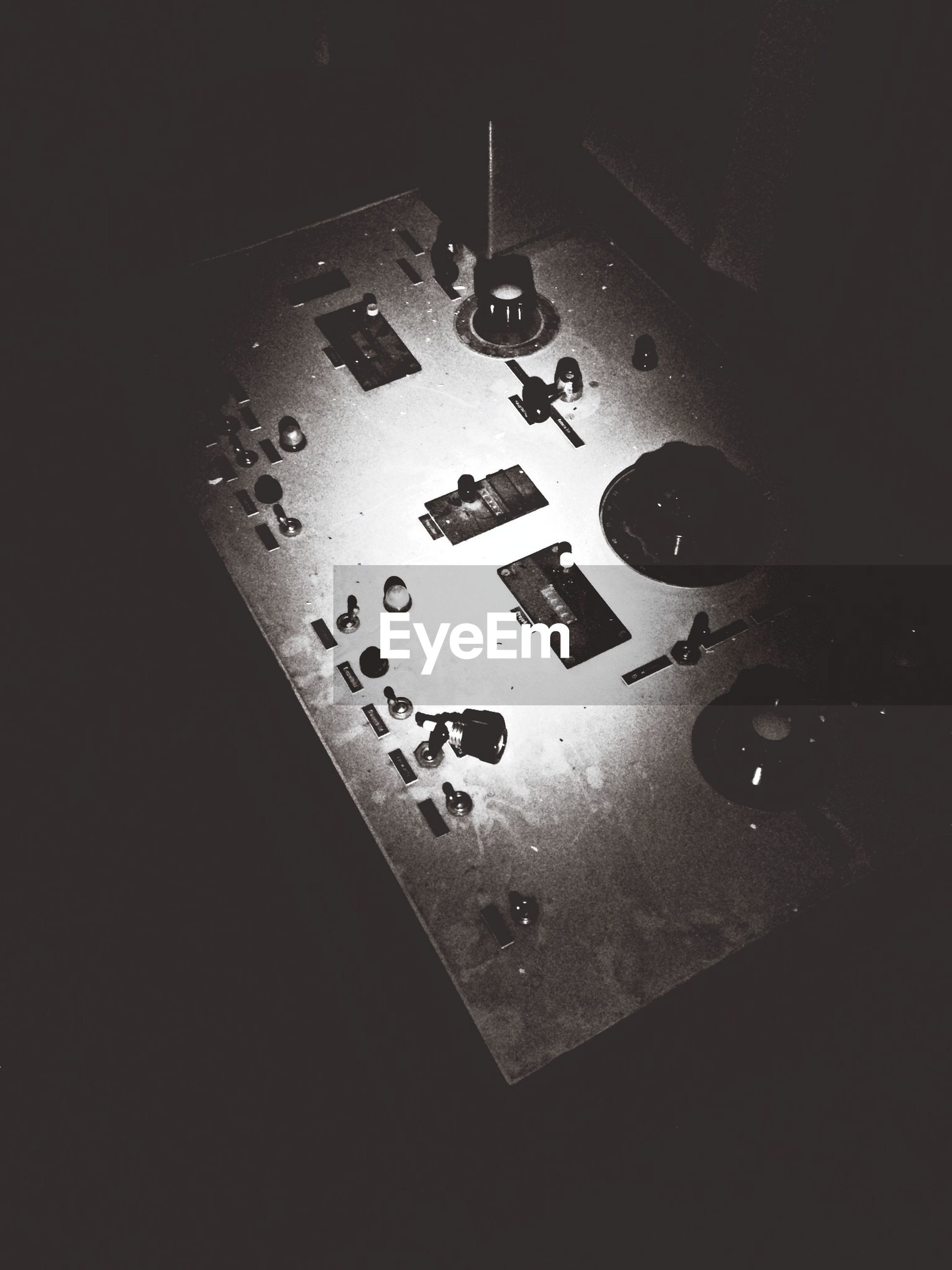 indoors, close-up, high angle view, technology, table, still life, wall - building feature, no people, connection, electricity, communication, illuminated, metal, studio shot, number, door, reflection, copy space, directly above, lighting equipment