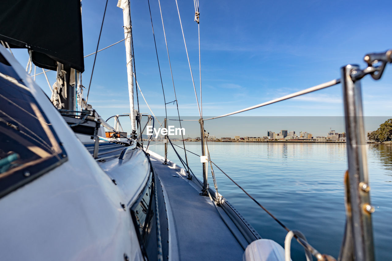 transportation, mode of transportation, water, nautical vessel, sailboat, sky, nature, no people, sea, travel, day, mast, pole, sailing, moored, outdoors, sunlight, rope, yacht, luxury