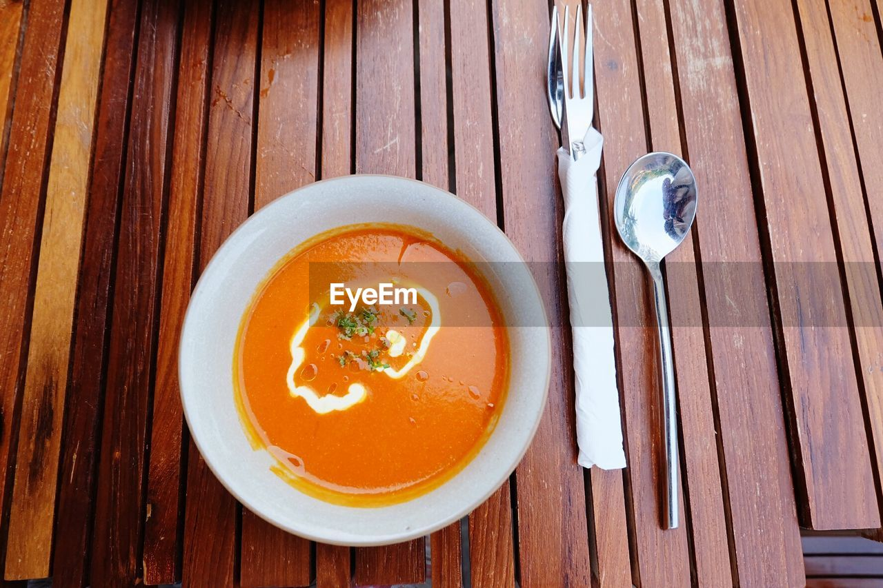 Directly Above Shot Of Soup On Wooden Table