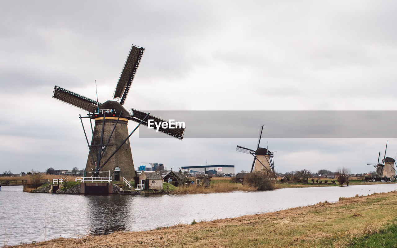 TRADITIONAL WINDMILL AGAINST CLOUDY SKY