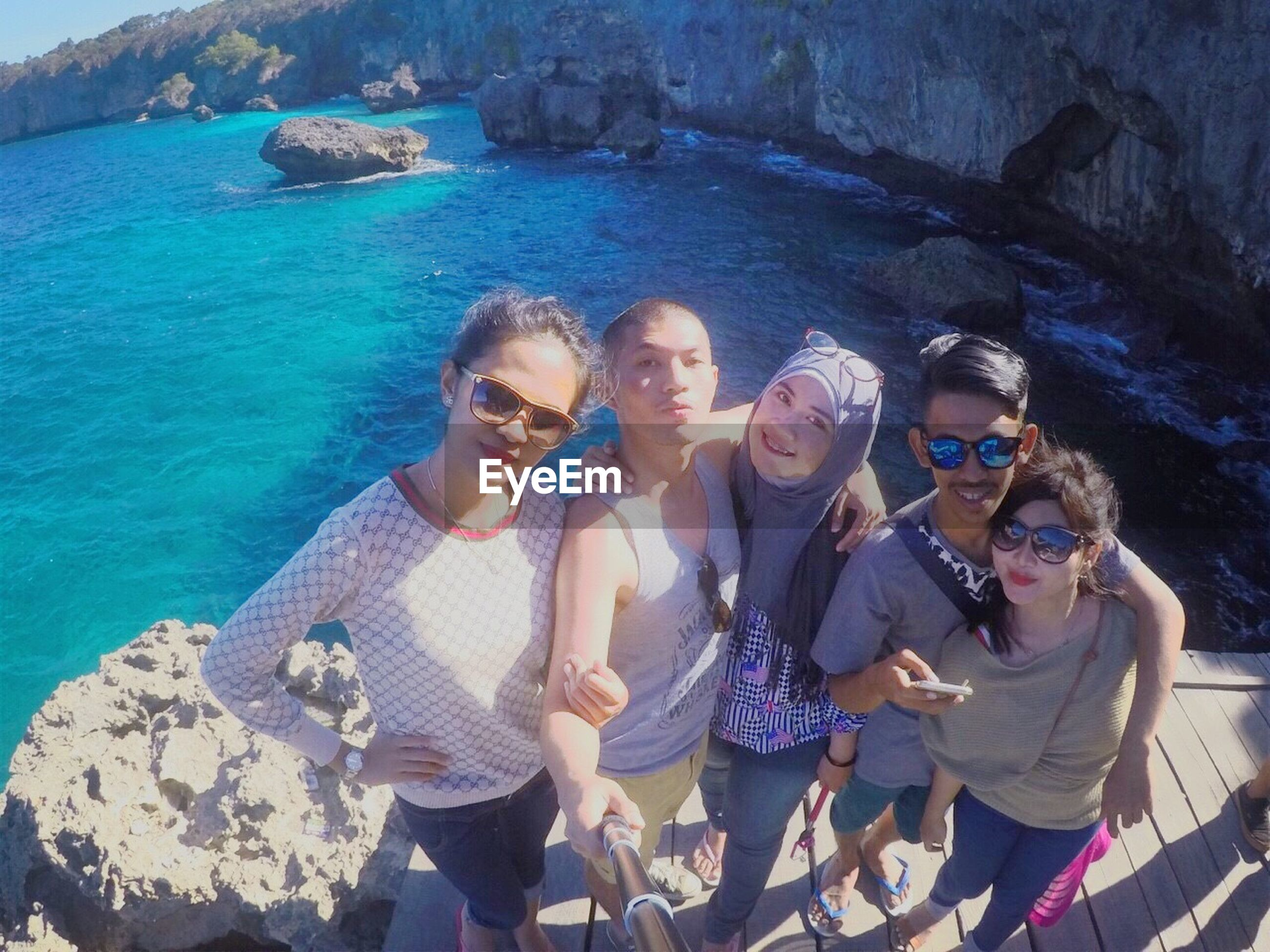lifestyles, leisure activity, togetherness, bonding, person, love, water, casual clothing, young men, enjoyment, young adult, friendship, vacations, happiness, smiling, fun, three quarter length