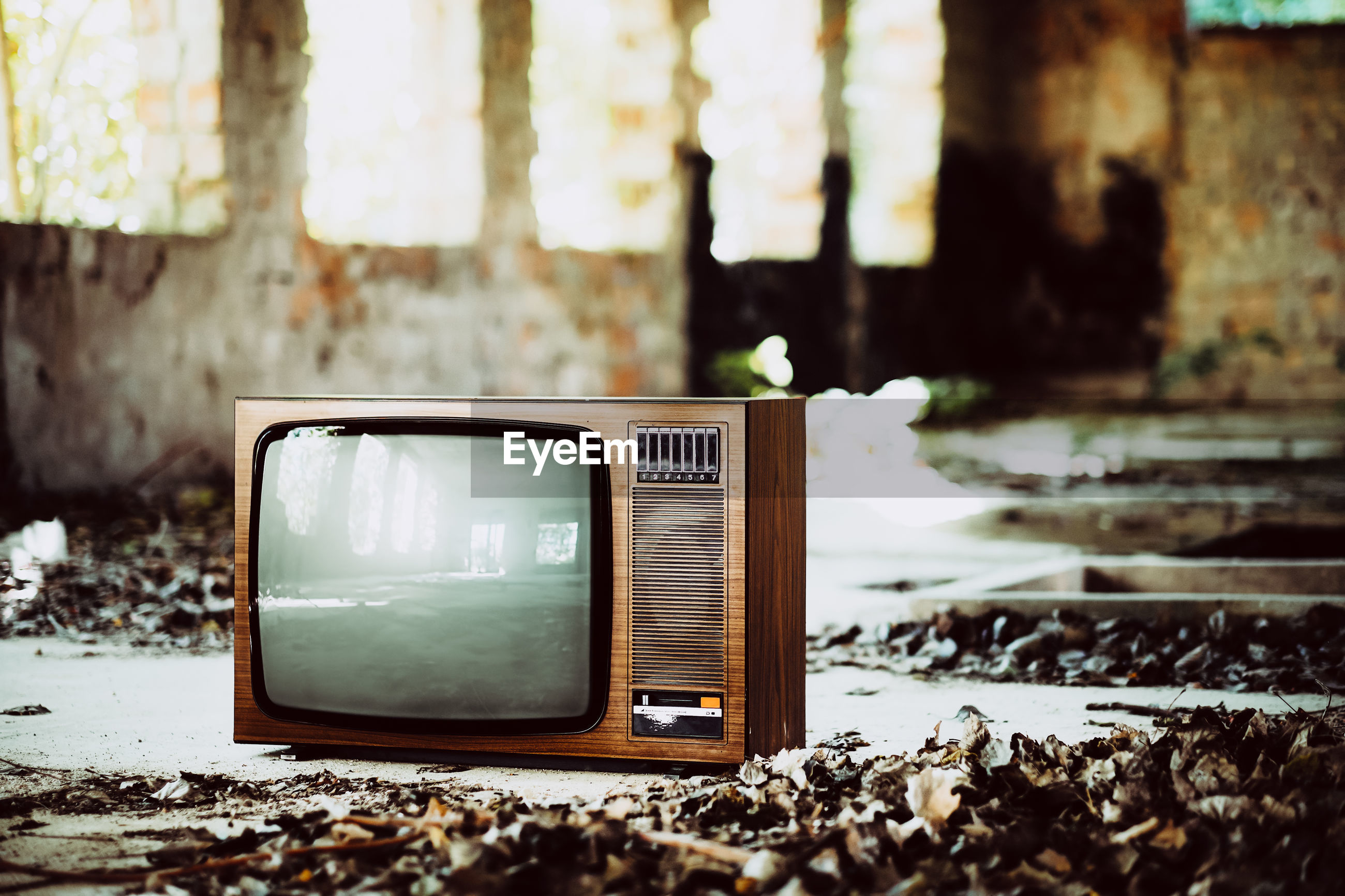 Old television set in abandoned house