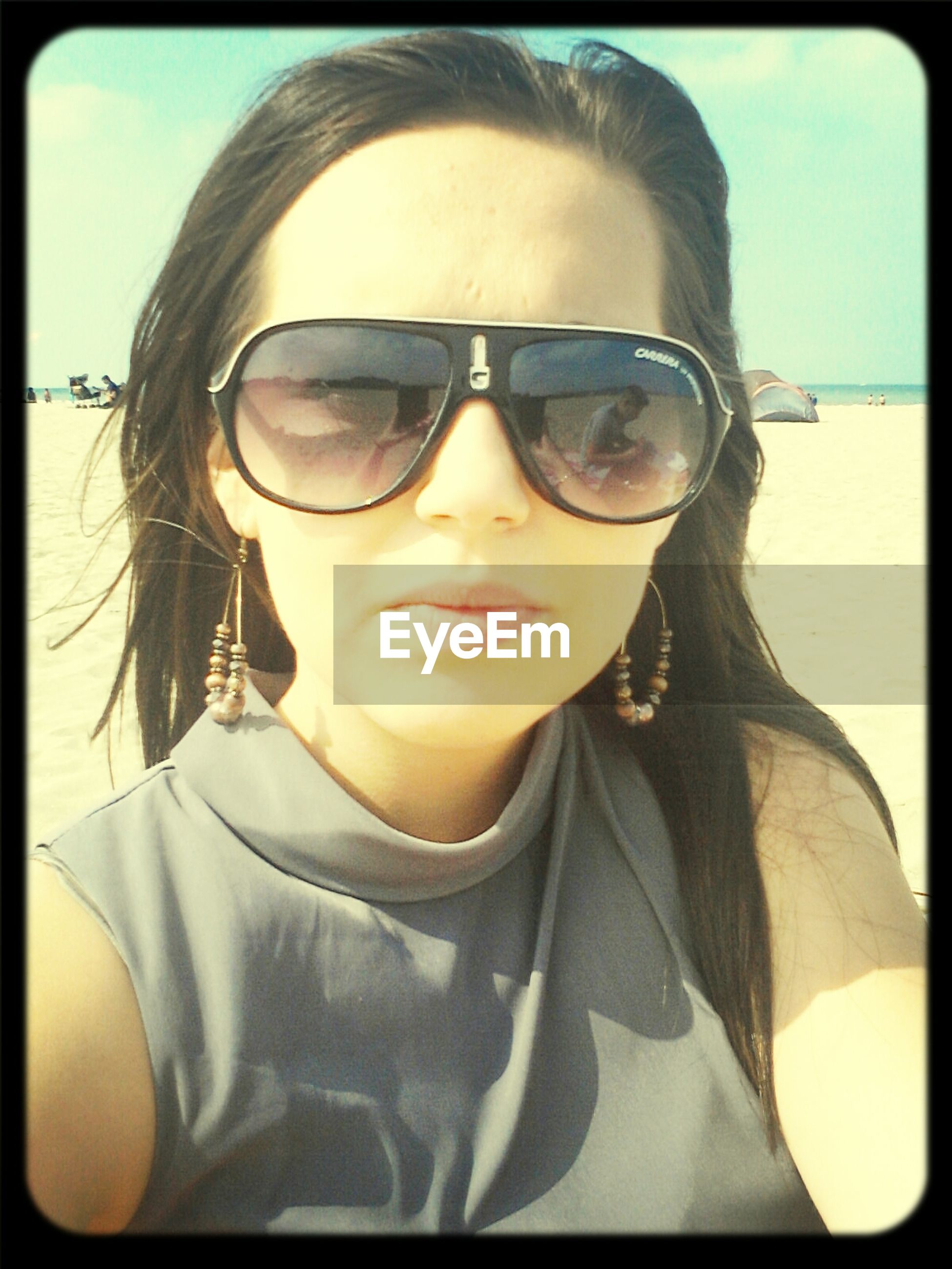 transfer print, portrait, looking at camera, person, lifestyles, front view, auto post production filter, sunglasses, young adult, leisure activity, headshot, smiling, head and shoulders, casual clothing, young women, eyeglasses, close-up, sunlight