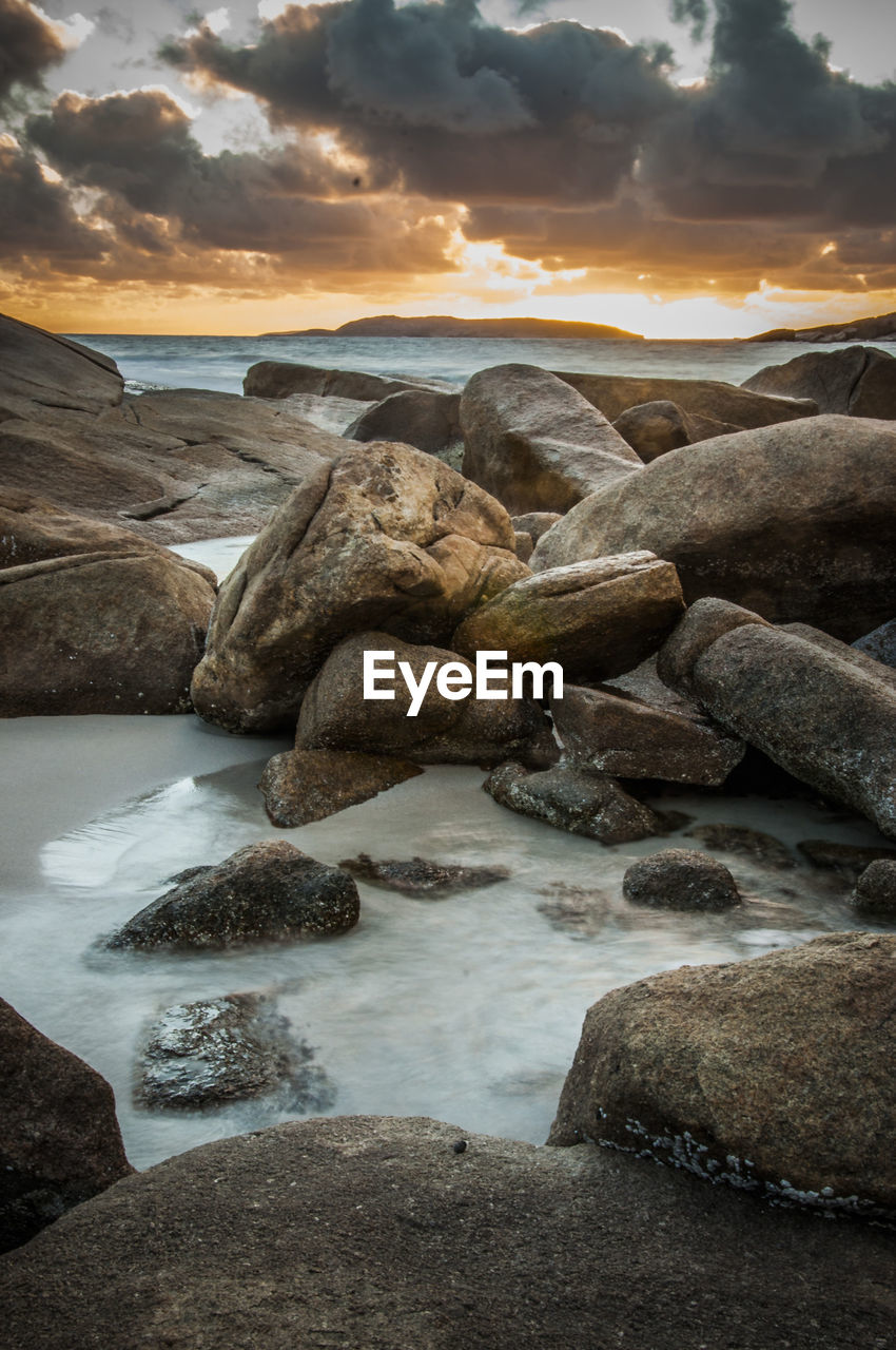 nature, beauty in nature, tranquil scene, scenics, water, tranquility, rock - object, sunset, no people, outdoors, sky, beach, sea, landscape, iceberg, day, pebble beach