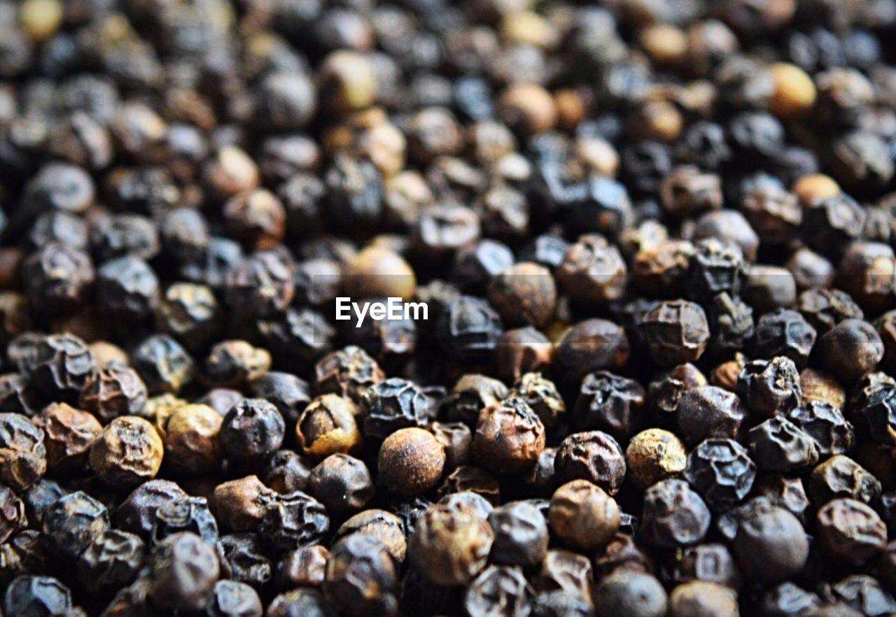 Full Frame Shot Of Black Peppercorns On Table