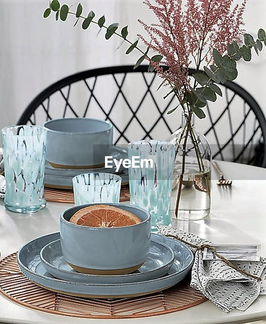 table, vase, flower, place setting, plate, dining table, no people, food and drink, tablecloth, dessert, napkin, tree, indoors, food, day, water, freshness, close-up