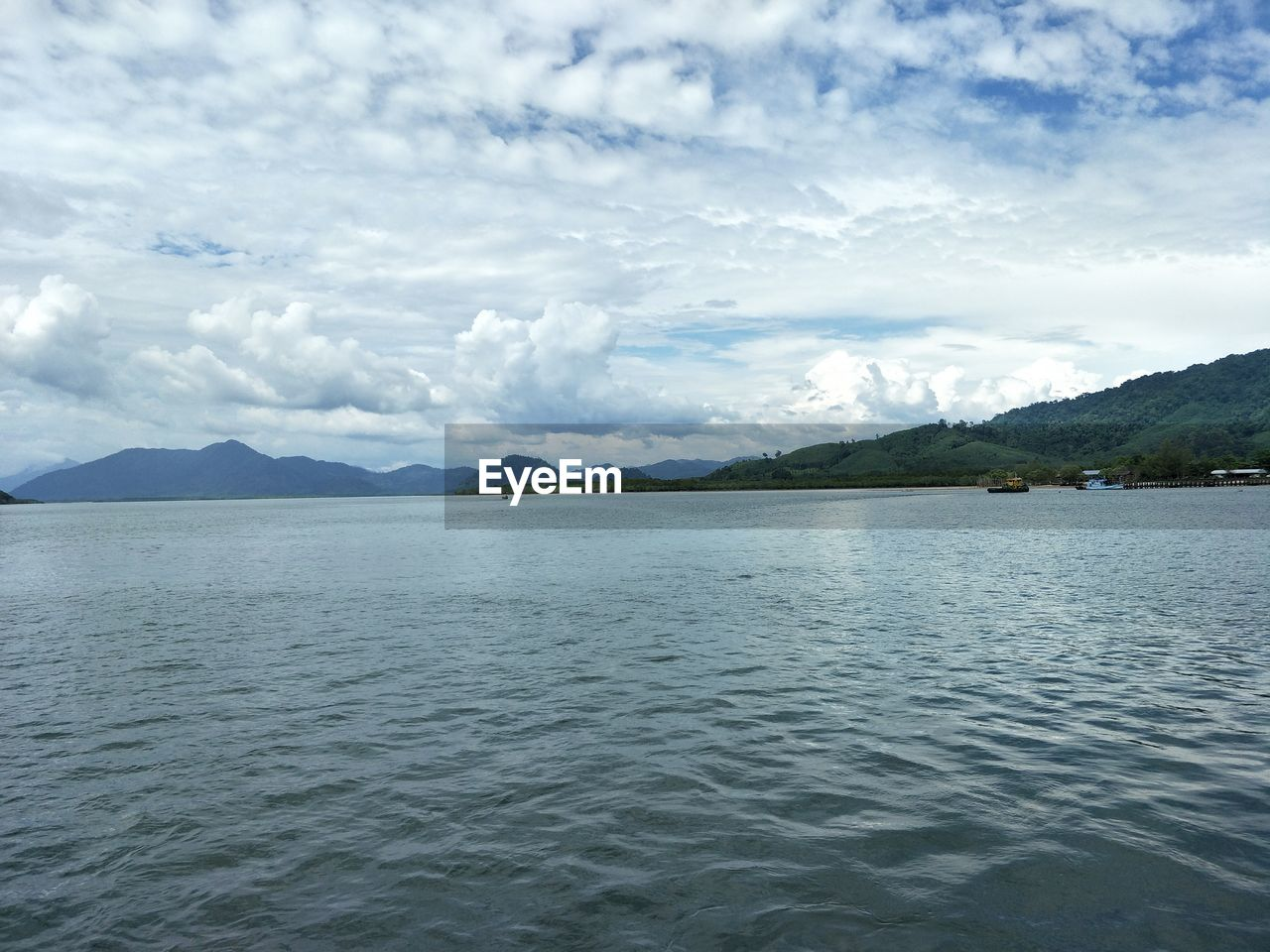 water, scenics - nature, sky, cloud - sky, beauty in nature, tranquil scene, tranquility, mountain, waterfront, sea, nature, idyllic, no people, day, non-urban scene, mountain range, rippled, remote, outdoors