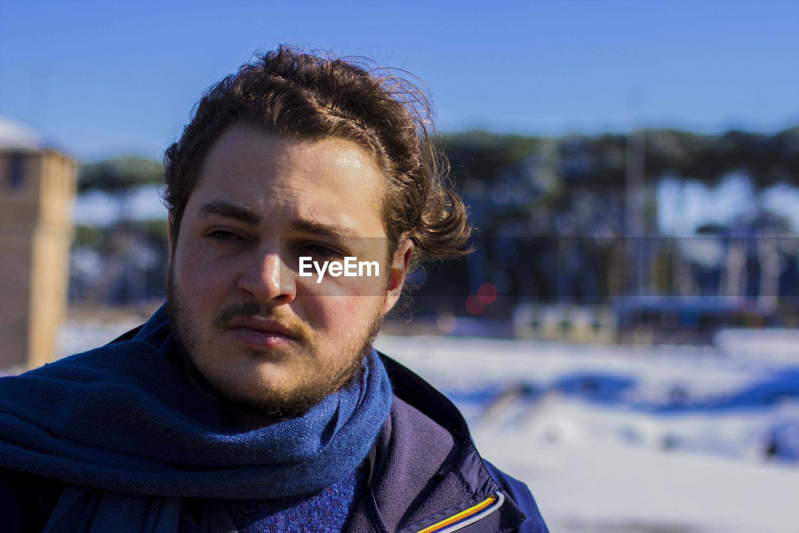 Young man looking away during winter