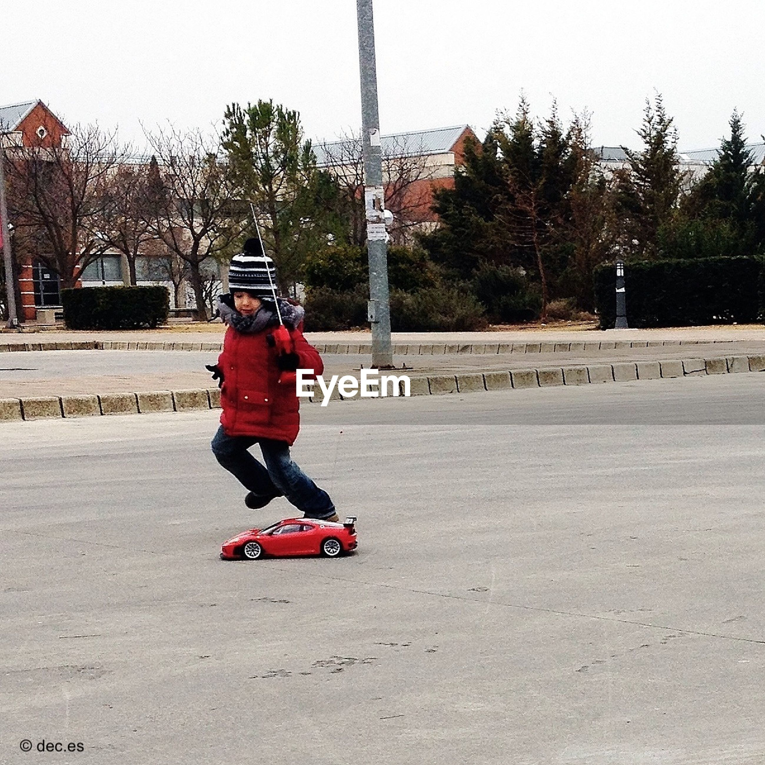 full length, childhood, lifestyles, leisure activity, tree, casual clothing, boys, elementary age, rear view, girls, park - man made space, walking, person, clear sky, playground, day, street, innocence