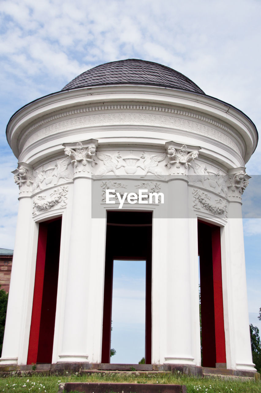 architecture, built structure, building exterior, sky, day, no people, cloud - sky, entrance, nature, building, architectural column, low angle view, door, outdoors, facade, text, white color, grass, design, tourism, neo-classical