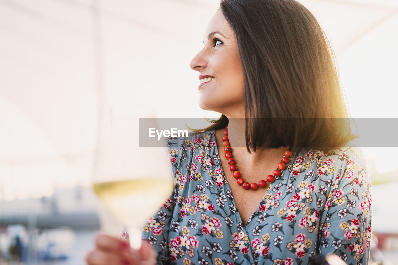 Woman Having Wine While Sitting In Restaurant