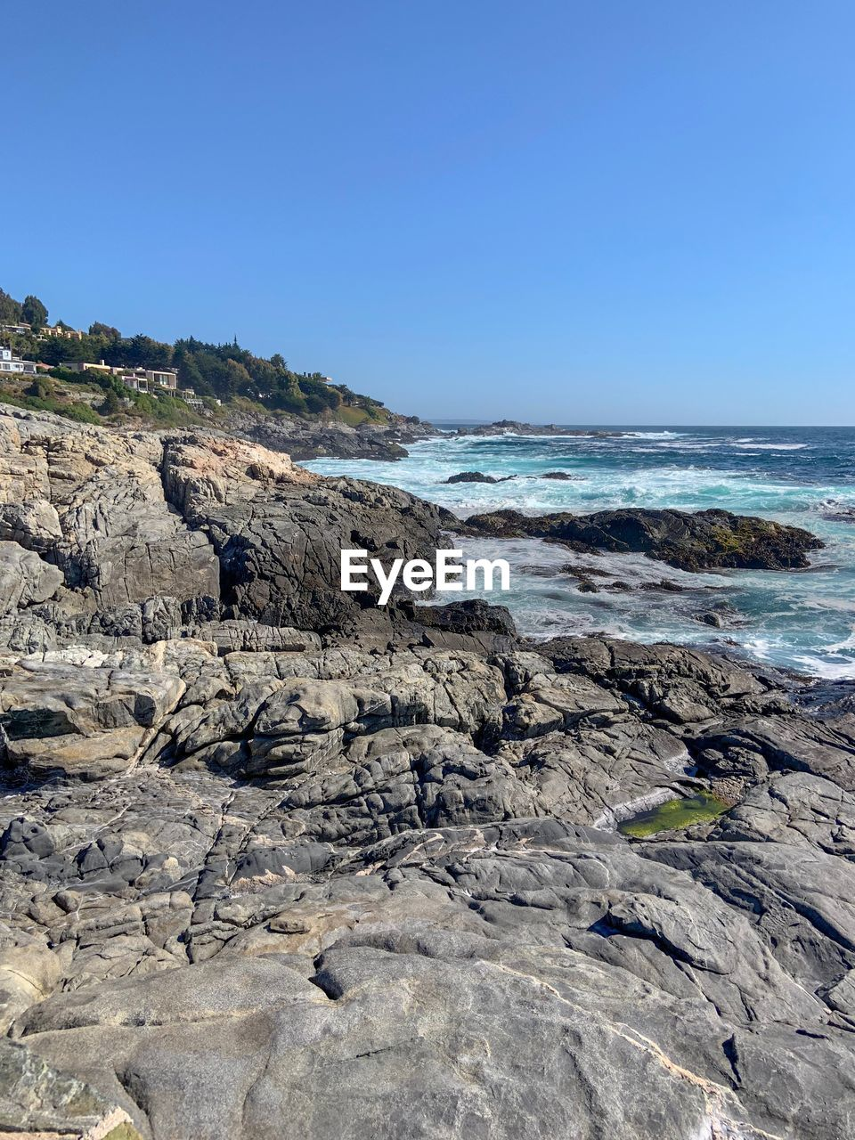 rock, sea, sky, rock - object, beauty in nature, water, solid, beach, land, scenics - nature, clear sky, nature, rock formation, day, no people, non-urban scene, copy space, tranquility, tranquil scene, horizon over water, outdoors, rocky coastline, marine