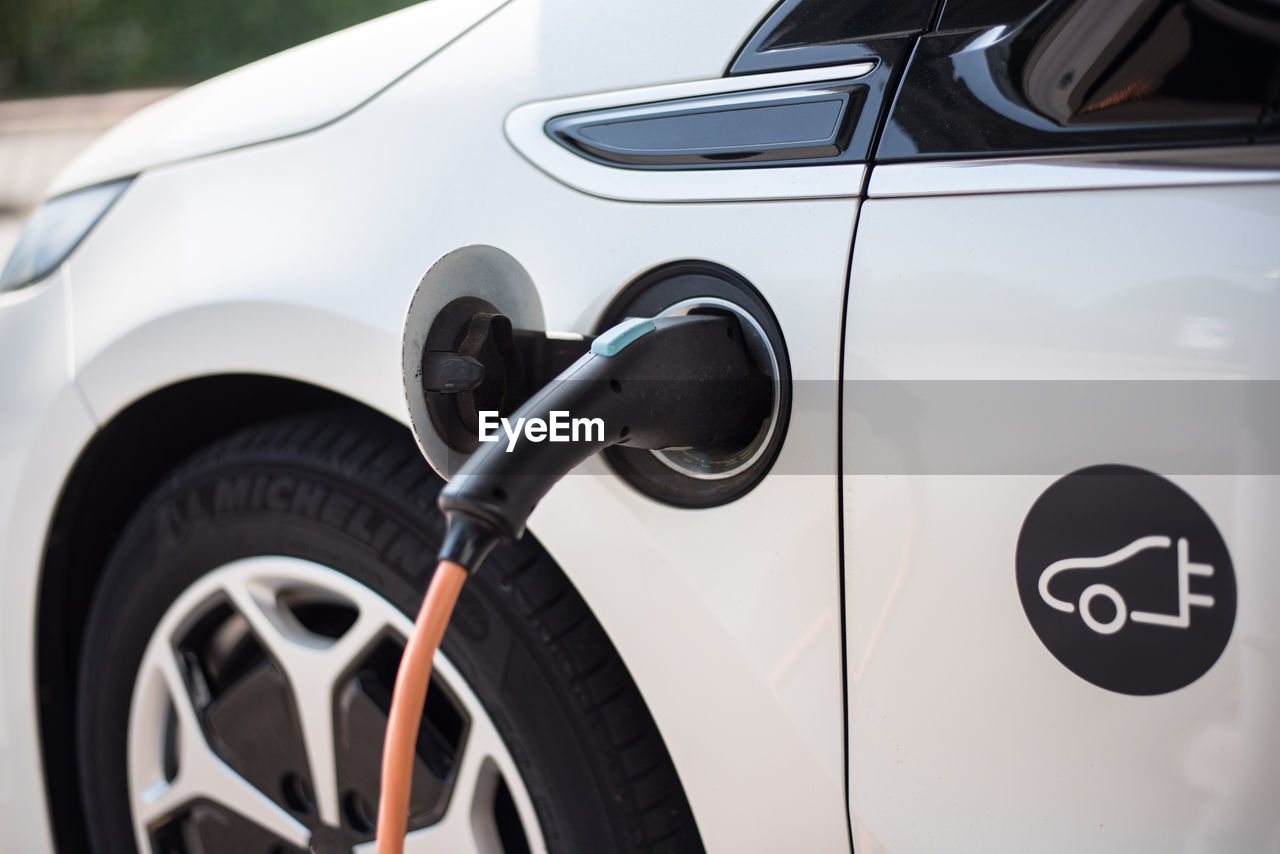 Close-up of electric car being charged