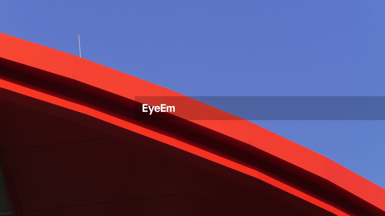 Cropped Image Of Red Building Against Clear Sky