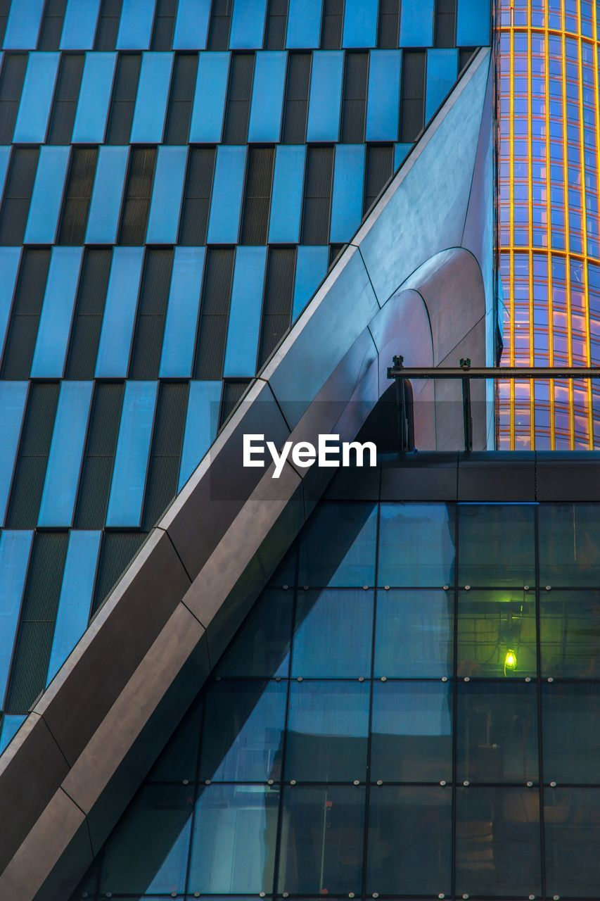 built structure, architecture, building exterior, low angle view, building, no people, city, office building exterior, modern, glass - material, office, outdoors, day, nature, reflection, blue, illuminated, sky, pattern, skyscraper, glass