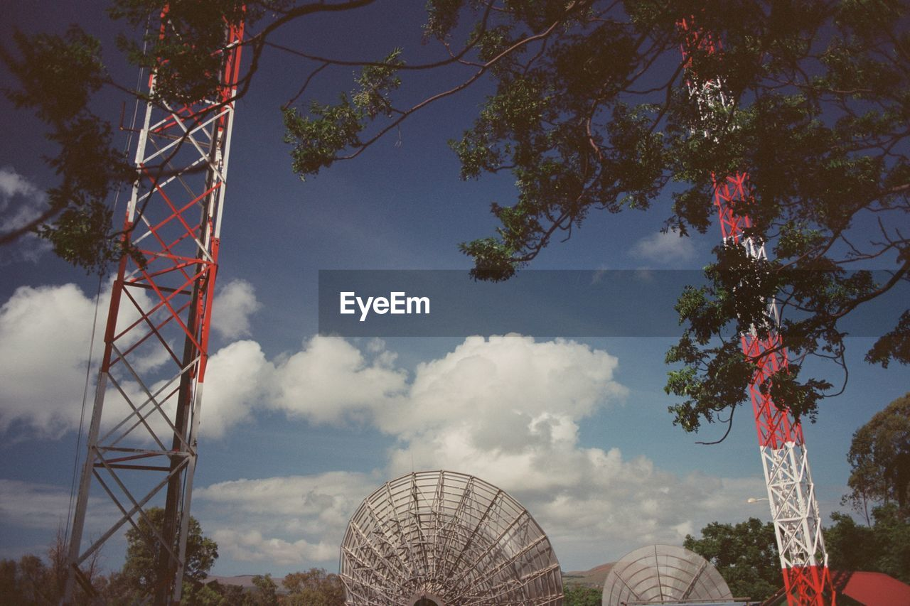 sky, plant, tree, cloud - sky, nature, low angle view, built structure, architecture, no people, day, technology, communication, outdoors, tower, connection, global communications, telecommunications equipment, branch, satellite dish, sunlight
