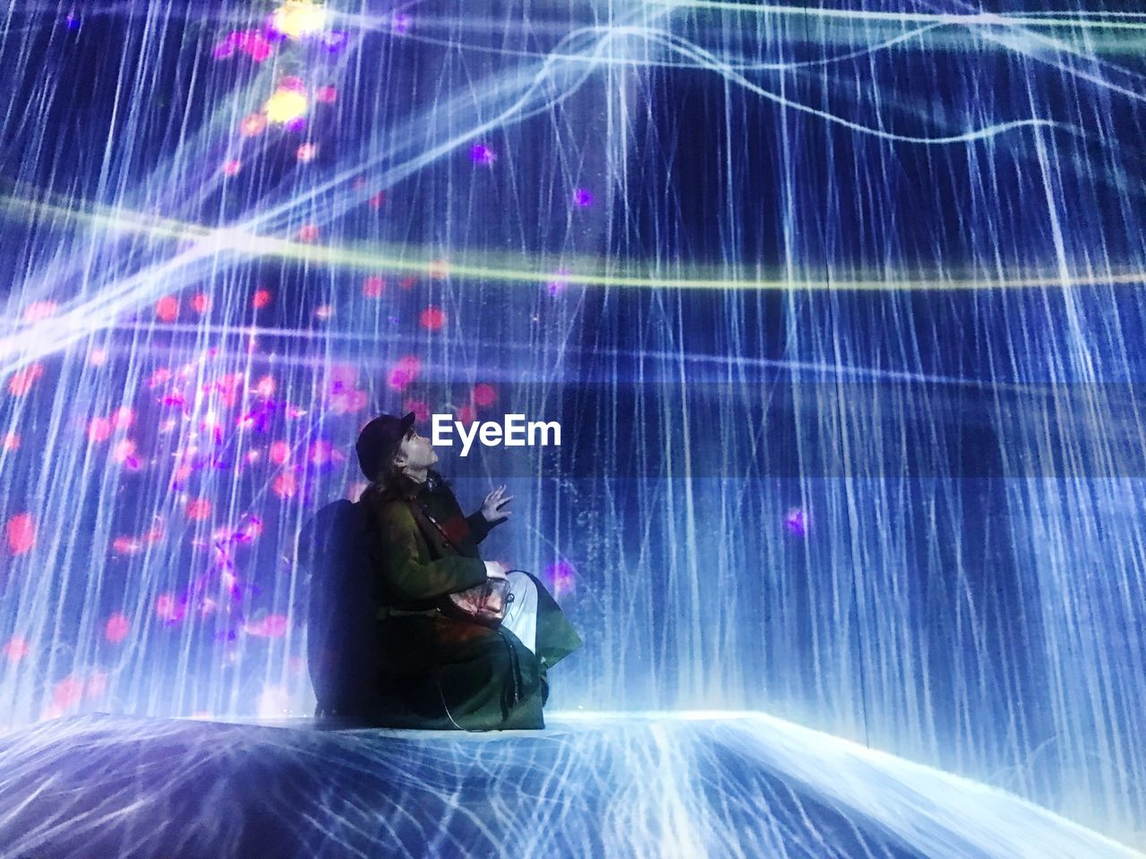 one person, illuminated, technology, long exposure, adult, indoors, men, motion, light - natural phenomenon, three quarter length, light beam, night, nature, skill, fuel and power generation, sitting, blurred motion, laser, digital composite