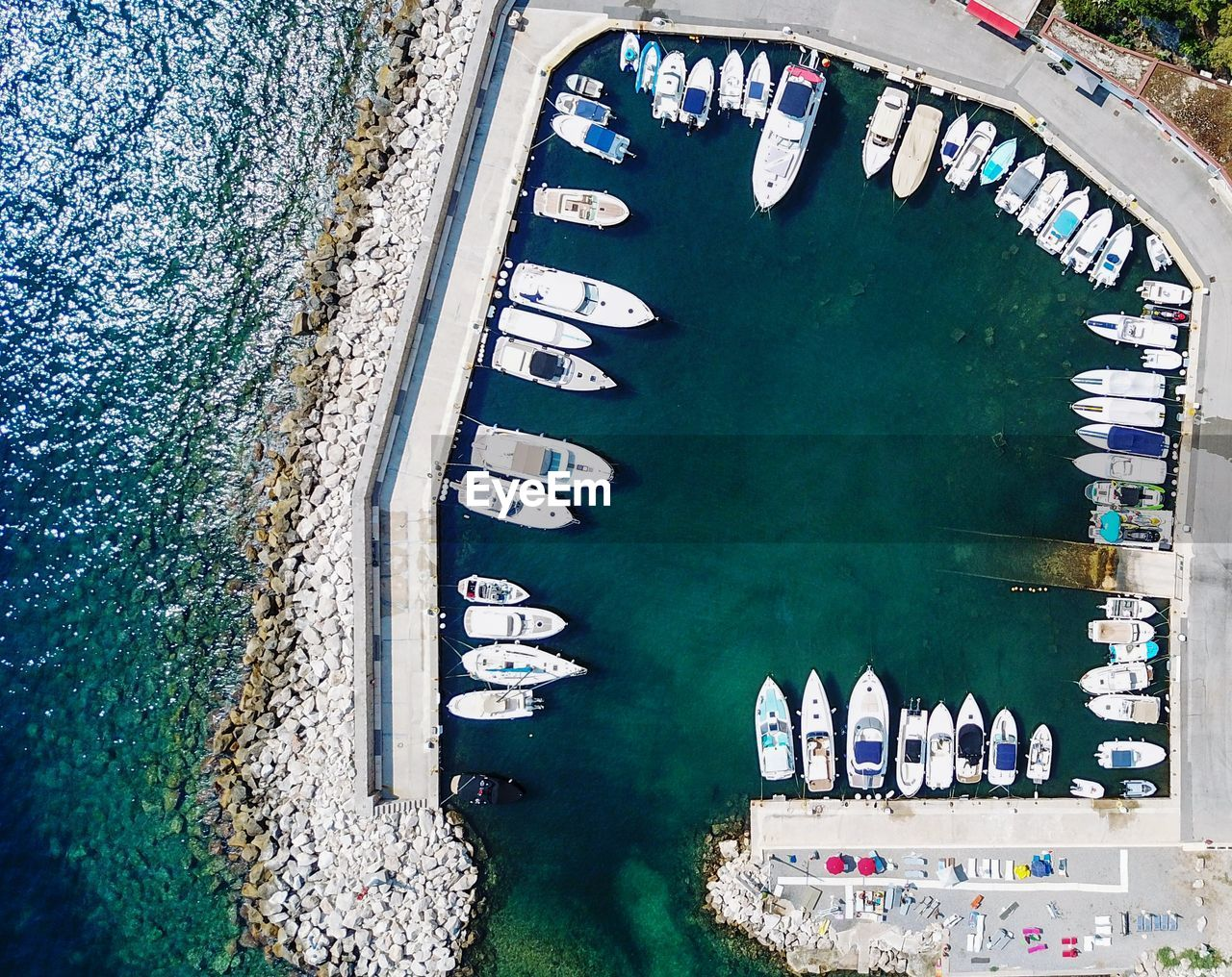 water, transportation, nautical vessel, high angle view, mode of transportation, day, built structure, architecture, sea, nature, travel, no people, outdoors, waterfront, travel destinations, moored