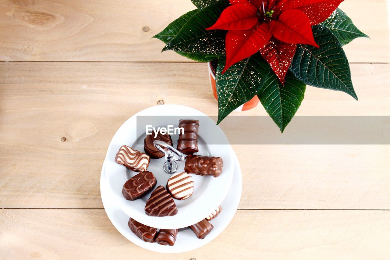 Close-Up Of Chocolate And Christmas Decoration On Table