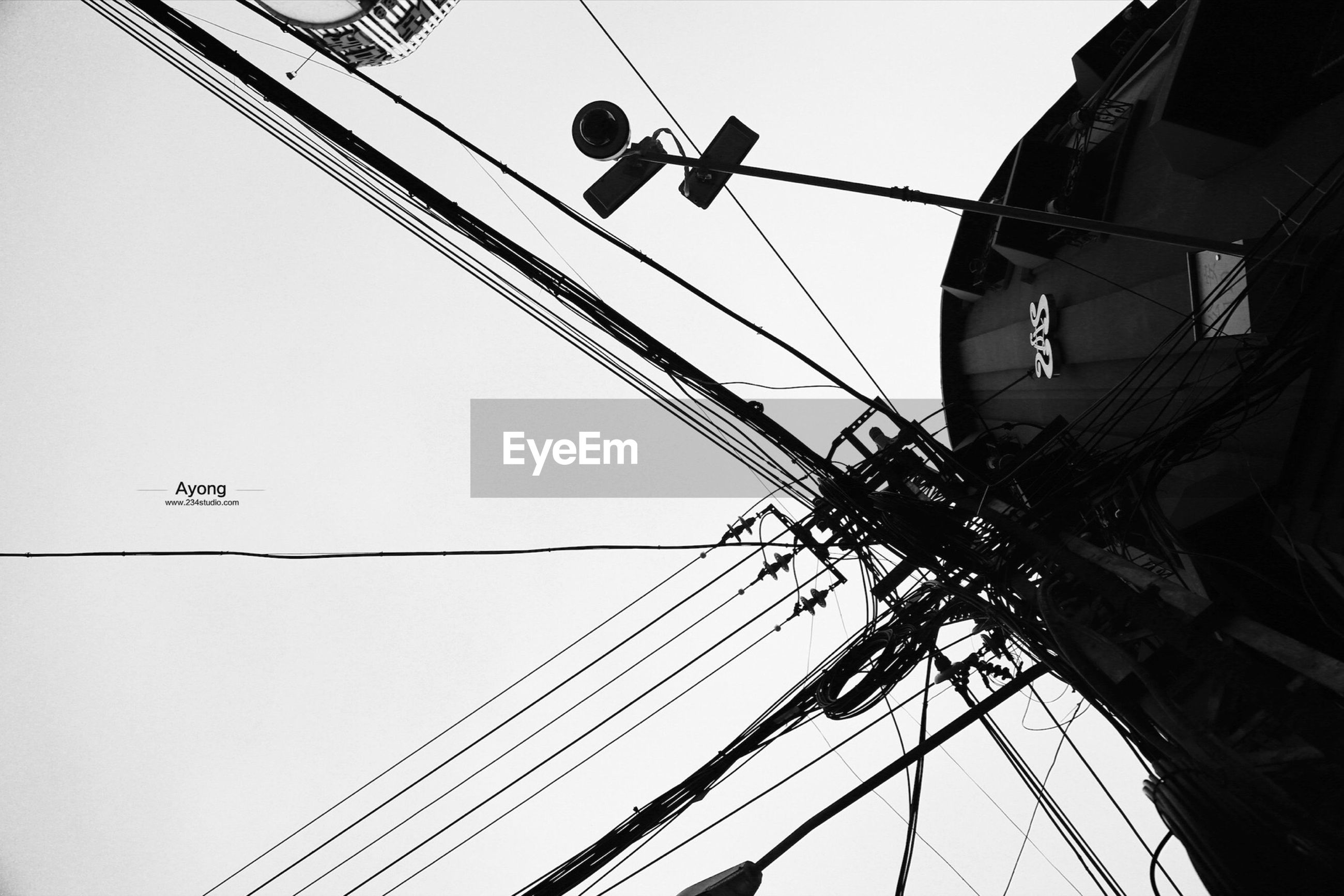power line, cable, electricity pylon, electricity, power supply, clear sky, low angle view, building exterior, built structure, connection, architecture, power cable, fuel and power generation, technology, sky, wire, outdoors, day, residential structure, house