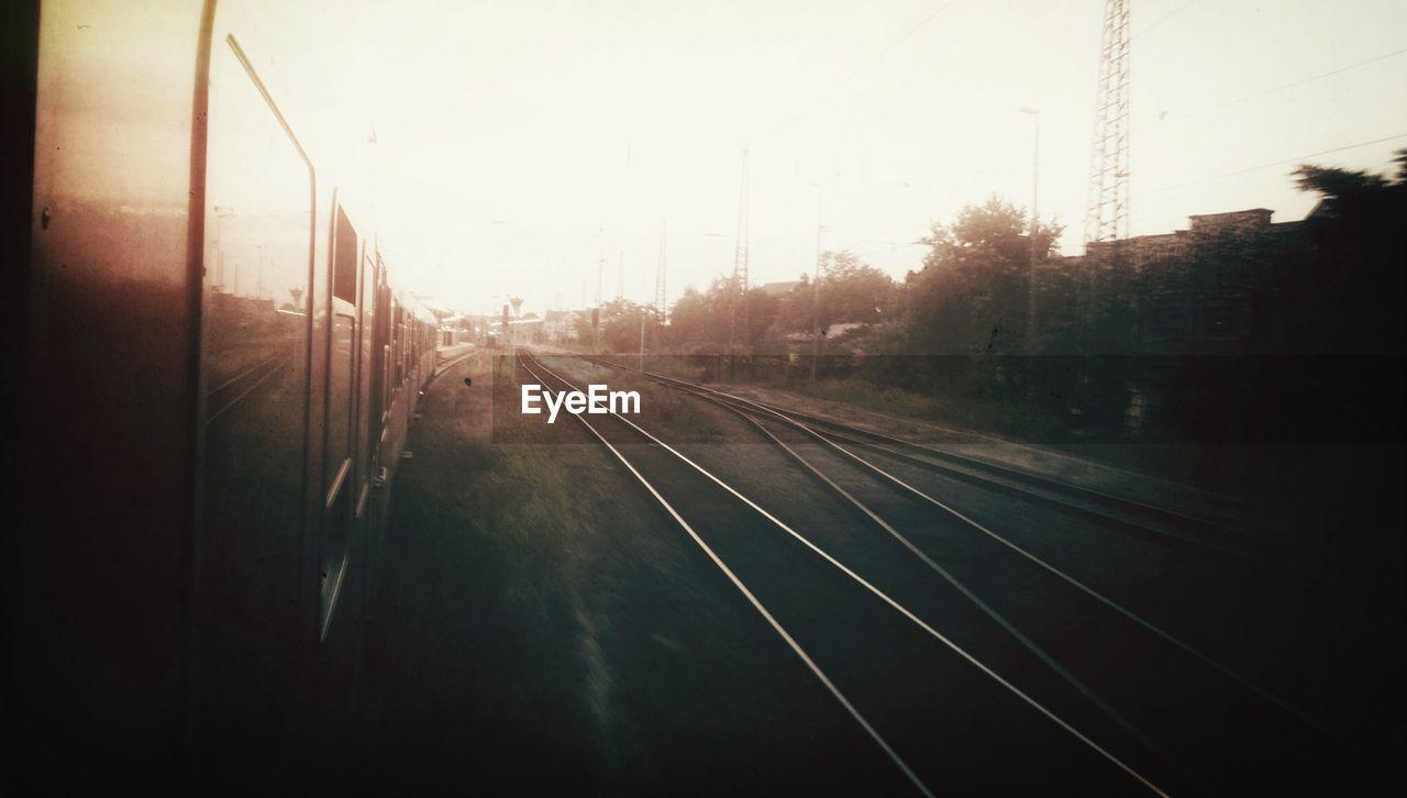 Train on railways at sunset