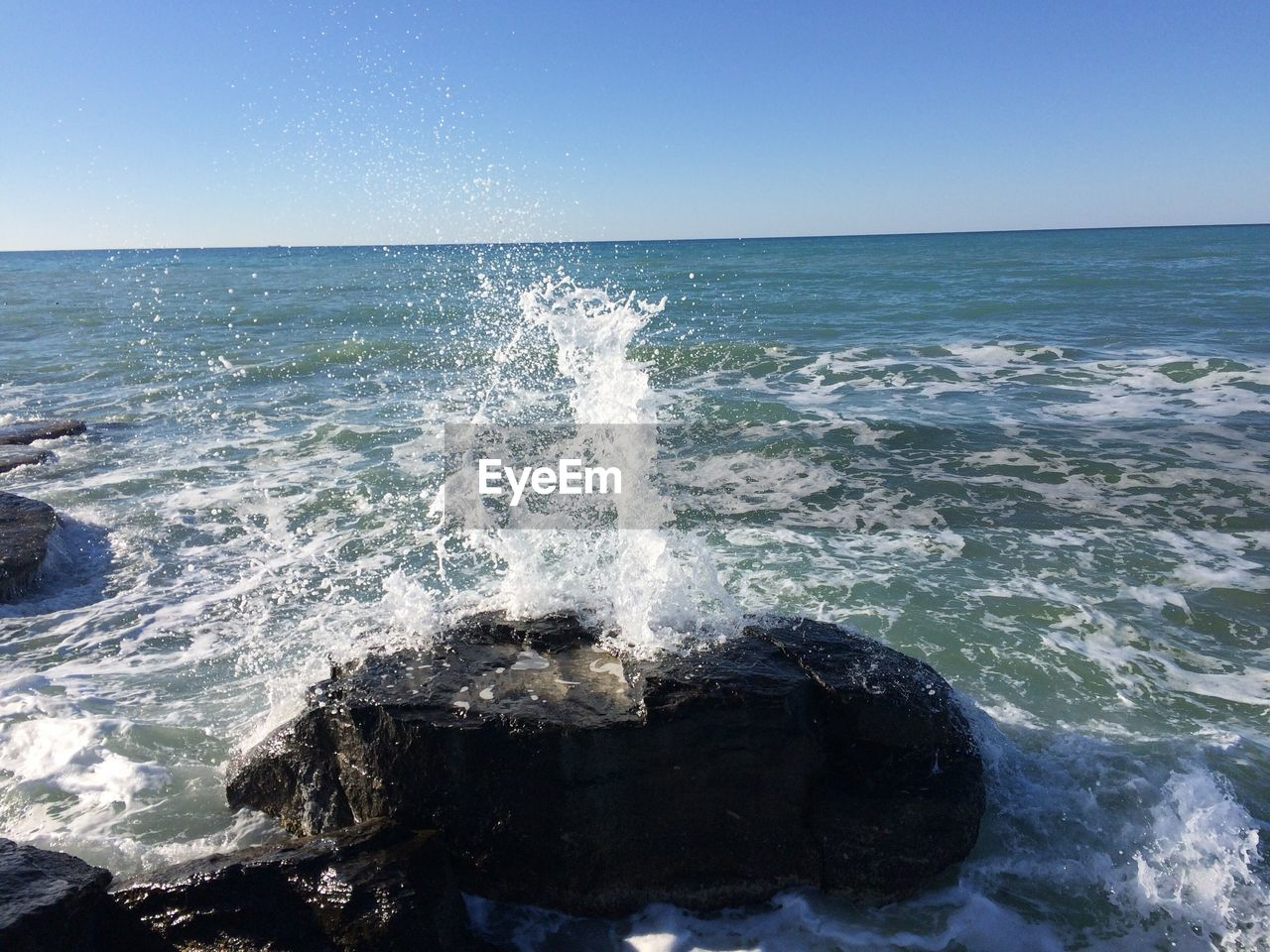 sea, water, nature, clear sky, beauty in nature, horizon over water, scenics, wave, motion, outdoors, no people, day, splashing, tranquility, tranquil scene, blue, sky, power in nature, force