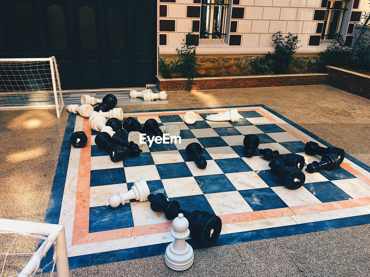 HIGH ANGLE VIEW OF CHESS PLAYING ON FLOOR