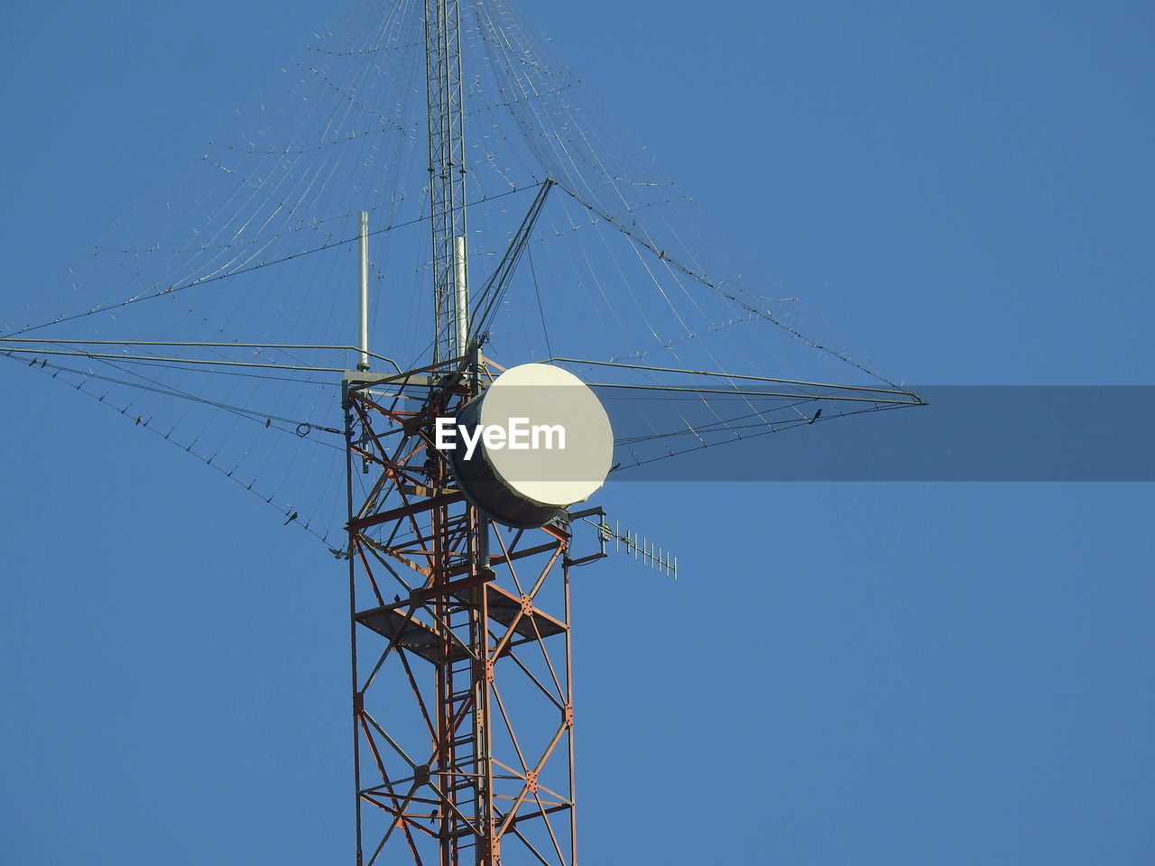 sky, low angle view, clear sky, blue, fuel and power generation, nature, technology, electricity, no people, connection, day, lighting equipment, cable, power supply, tall - high, outdoors, copy space, built structure, electricity pylon, metal