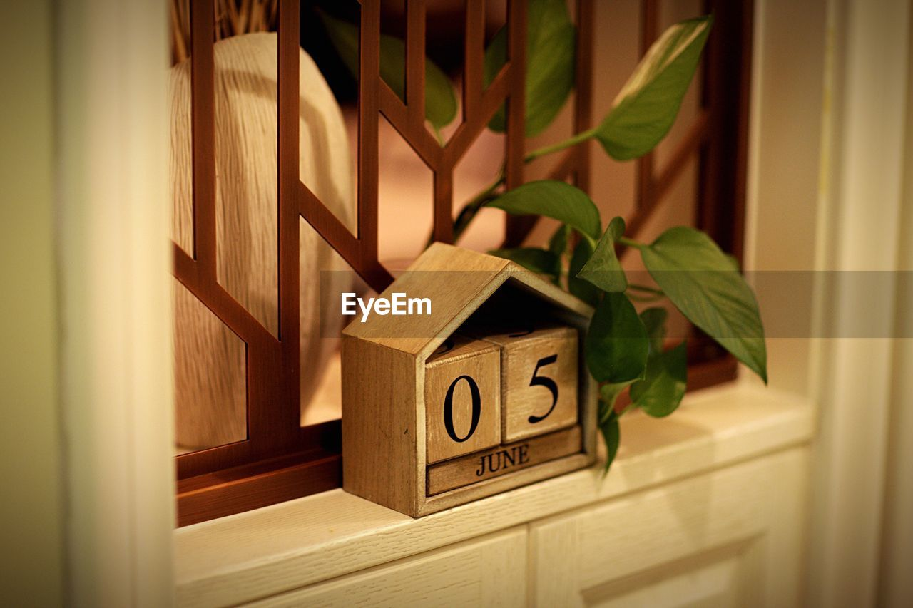 indoors, wood - material, door, no people, communication, home interior, close-up, open, built structure, day, home showcase interior, architecture