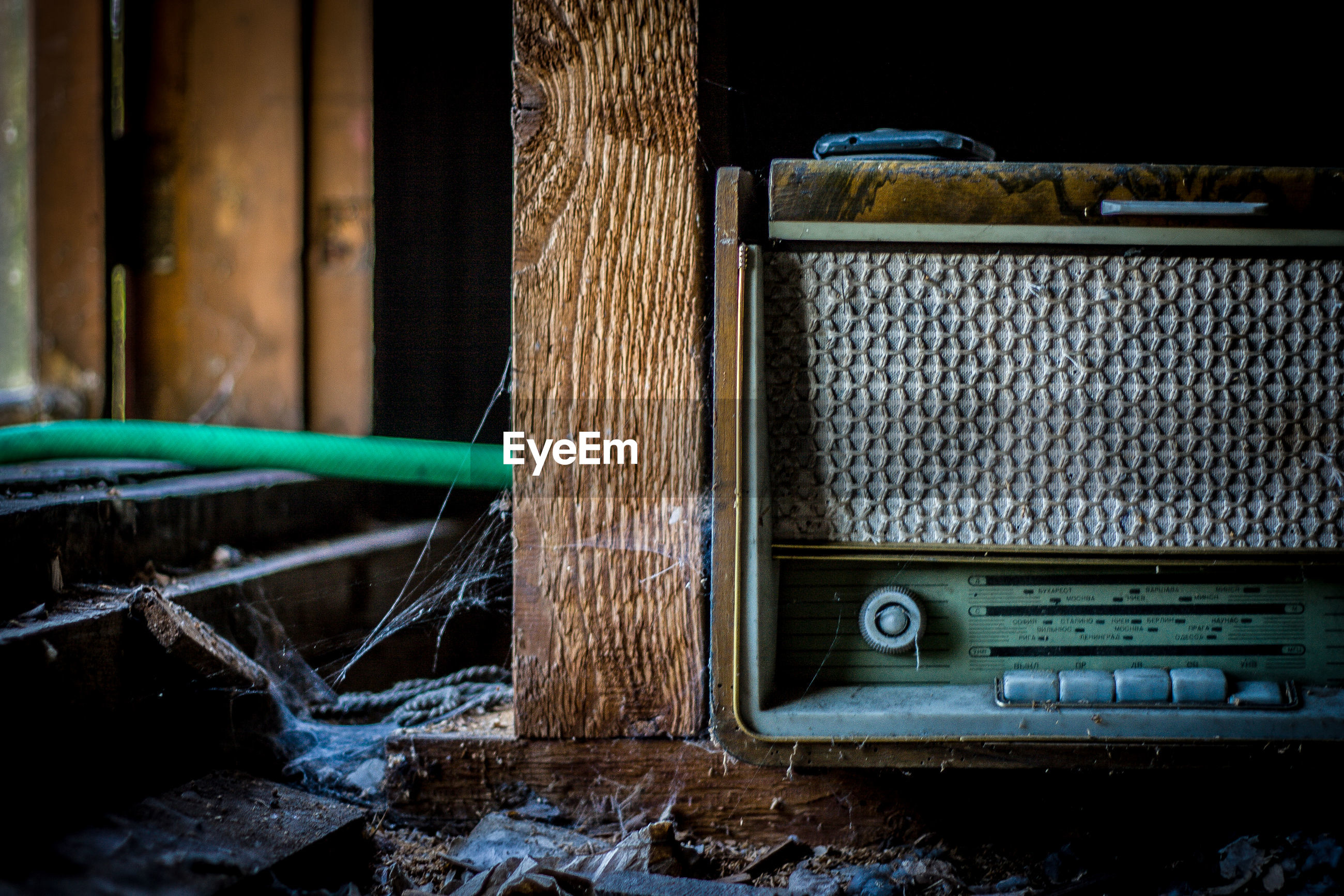Close-up of old radio in abandoned shelf