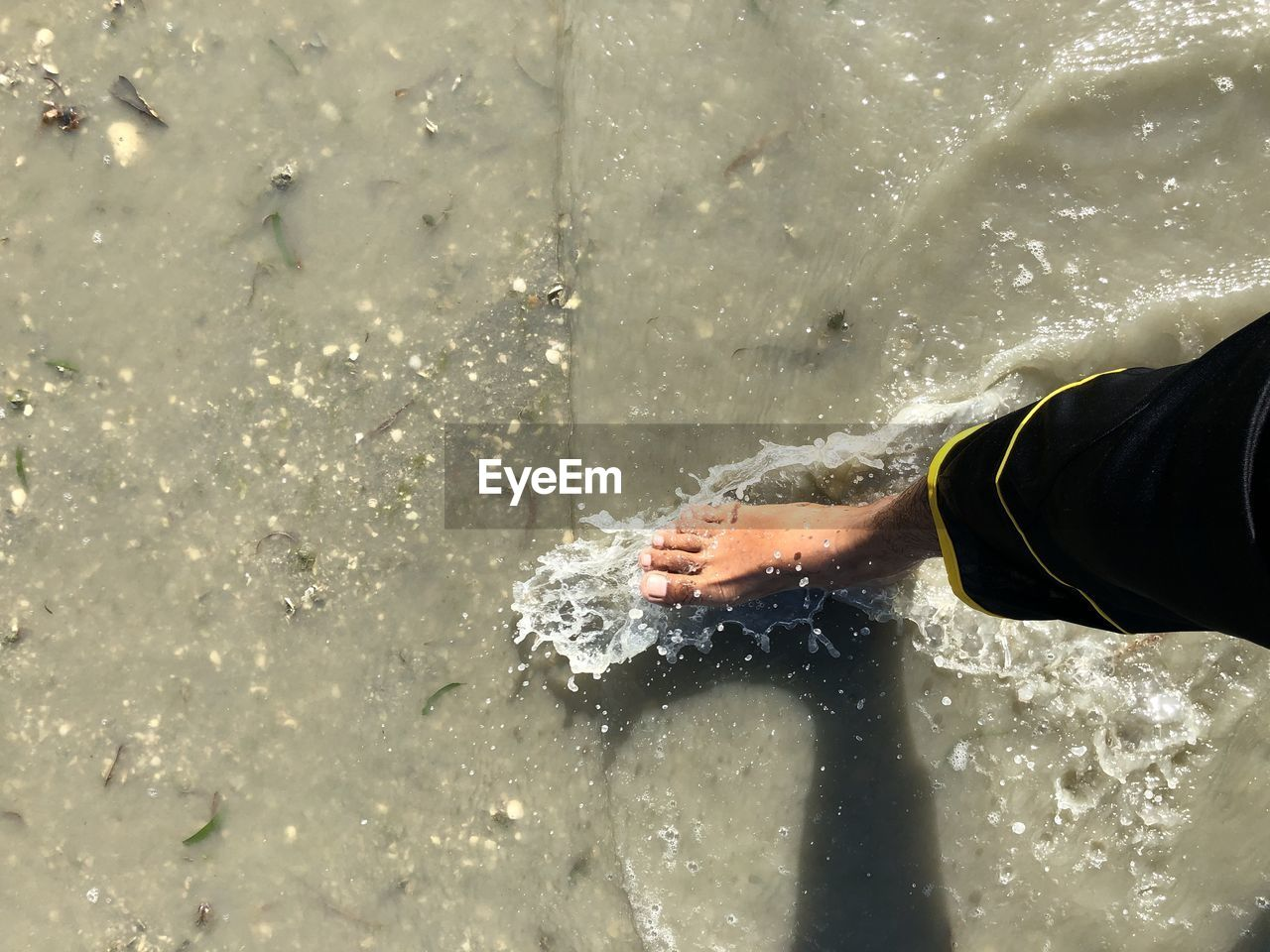 real people, one person, human body part, water, lifestyles, motion, human hand, body part, hand, unrecognizable person, leisure activity, nature, day, splashing, outdoors, human leg, men, sea, spraying, human foot, finger, flowing water