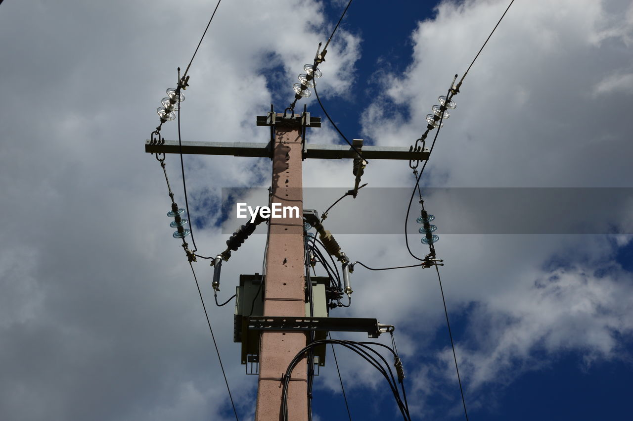 cloud - sky, sky, low angle view, nature, no people, day, built structure, connection, technology, machinery, metal, crane - construction machinery, architecture, outdoors, construction industry, communication, cable, industry, blue, tall - high, power supply, electrical equipment