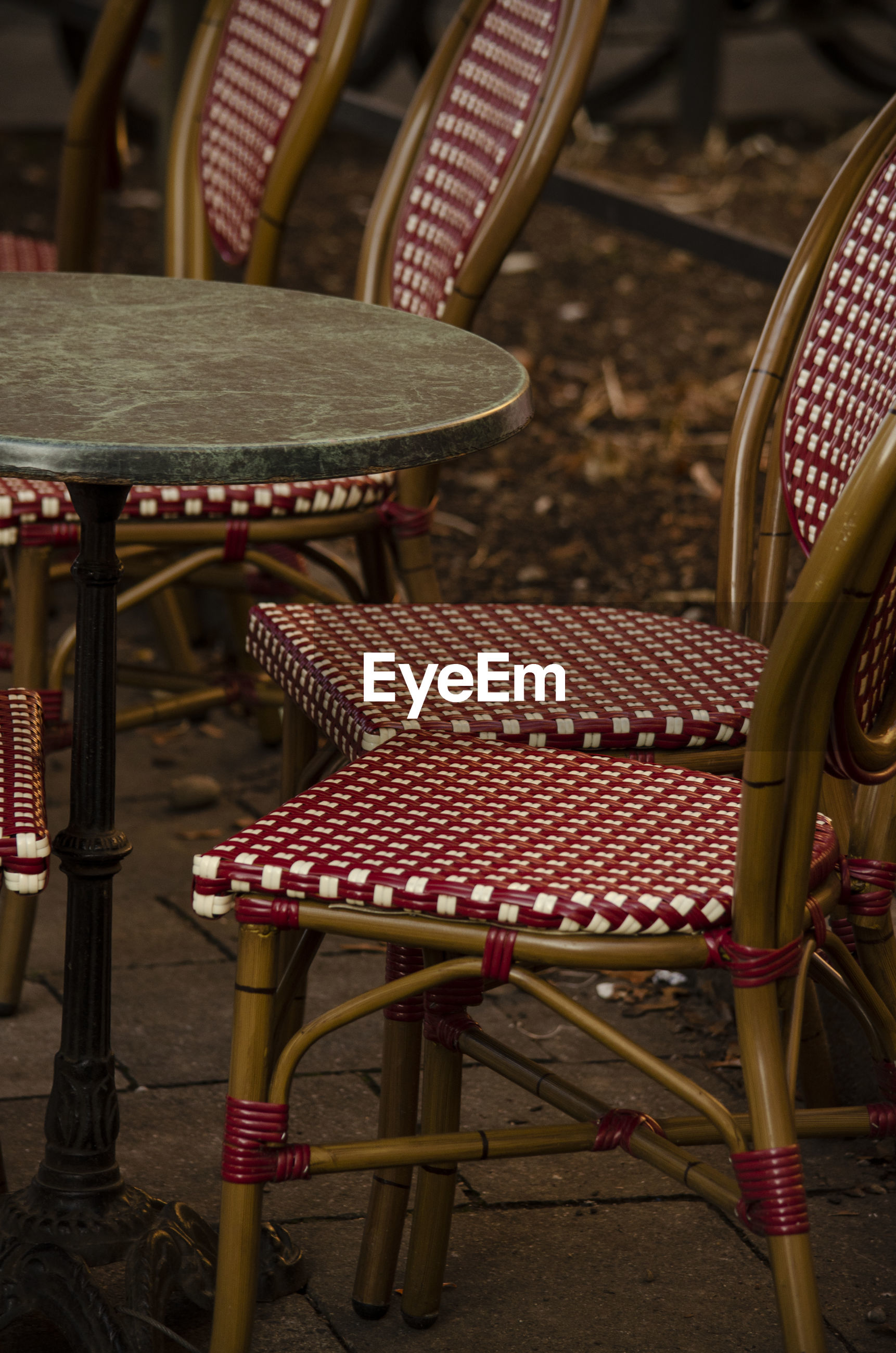 Empty chairs by table