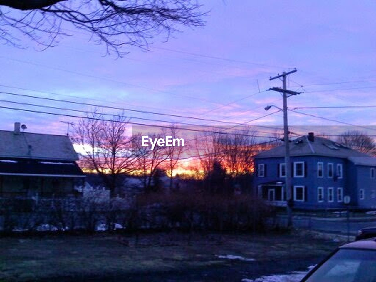 cable, built structure, power line, electricity, house, electricity pylon, building exterior, architecture, power supply, no people, residential building, connection, silhouette, sky, tree, outdoors, winter, technology, fuel and power generation, day, telephone line, city