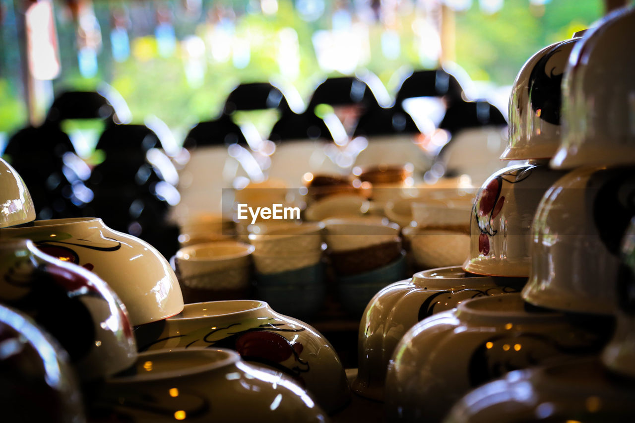 large group of objects, selective focus, in a row, still life, close-up, indoors, for sale, arrangement, no people, retail, choice, market, focus on foreground, business, abundance, stack, variation, table, food and drink, retail display