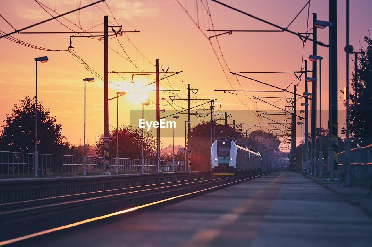 Train On Track Amidst Electricity Pylon
