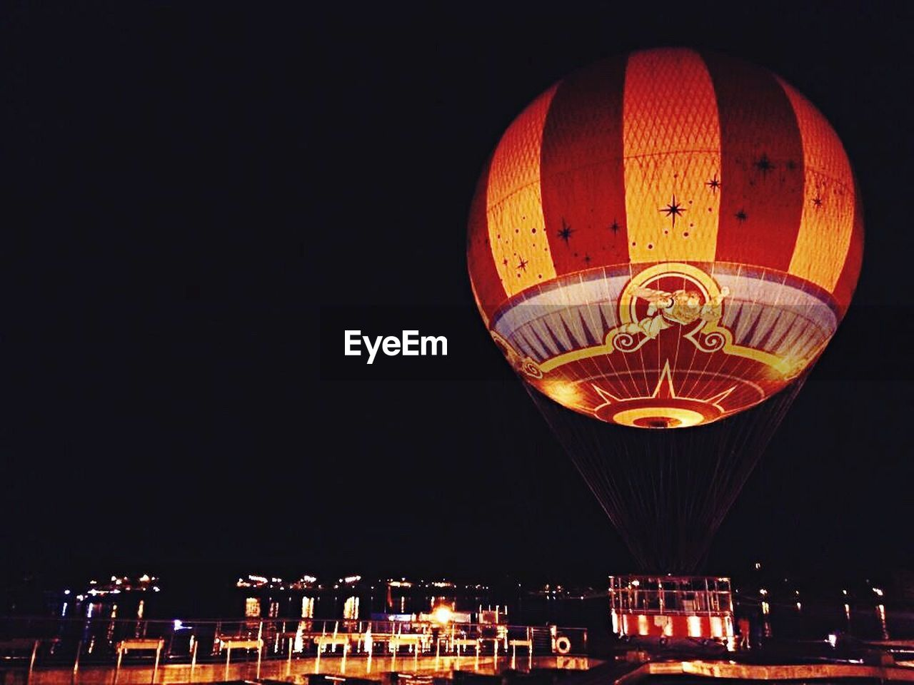 night, illuminated, celebration, traditional festival, multi colored, hot air balloon, chinese new year, flying, outdoors, sky, no people, city, ballooning festival, astronomy