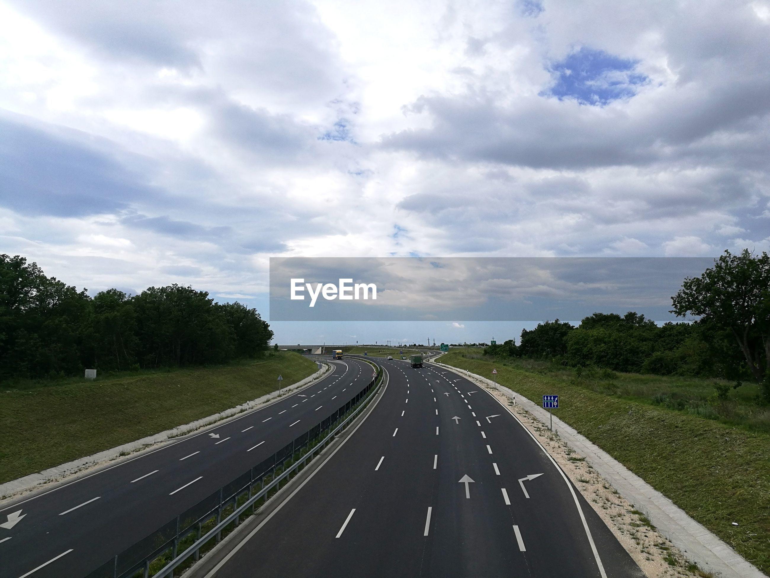 Highway by road against sky