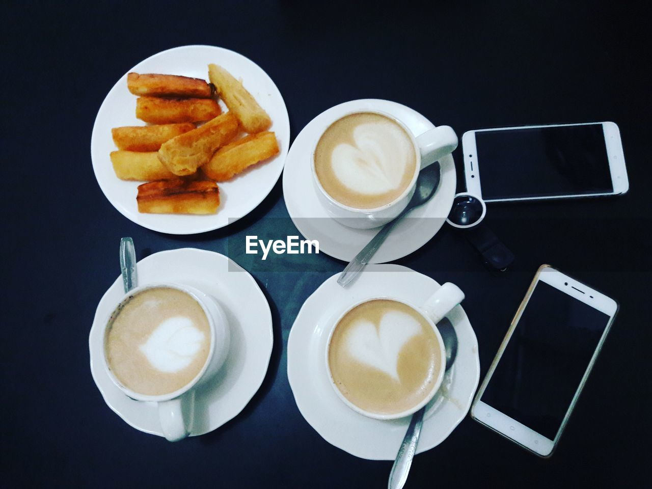 food and drink, cup, coffee, drink, coffee cup, mug, refreshment, coffee - drink, ready-to-eat, table, frothy drink, indoors, still life, no people, freshness, food, hot drink, french fries, eating utensil, kitchen utensil, crockery, fried, meal, snack, latte, breakfast, tray