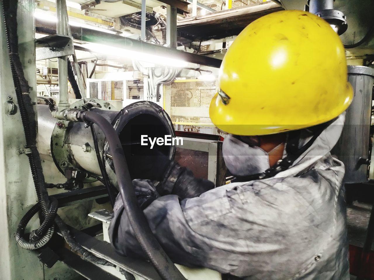 PEOPLE WORKING IN MACHINE