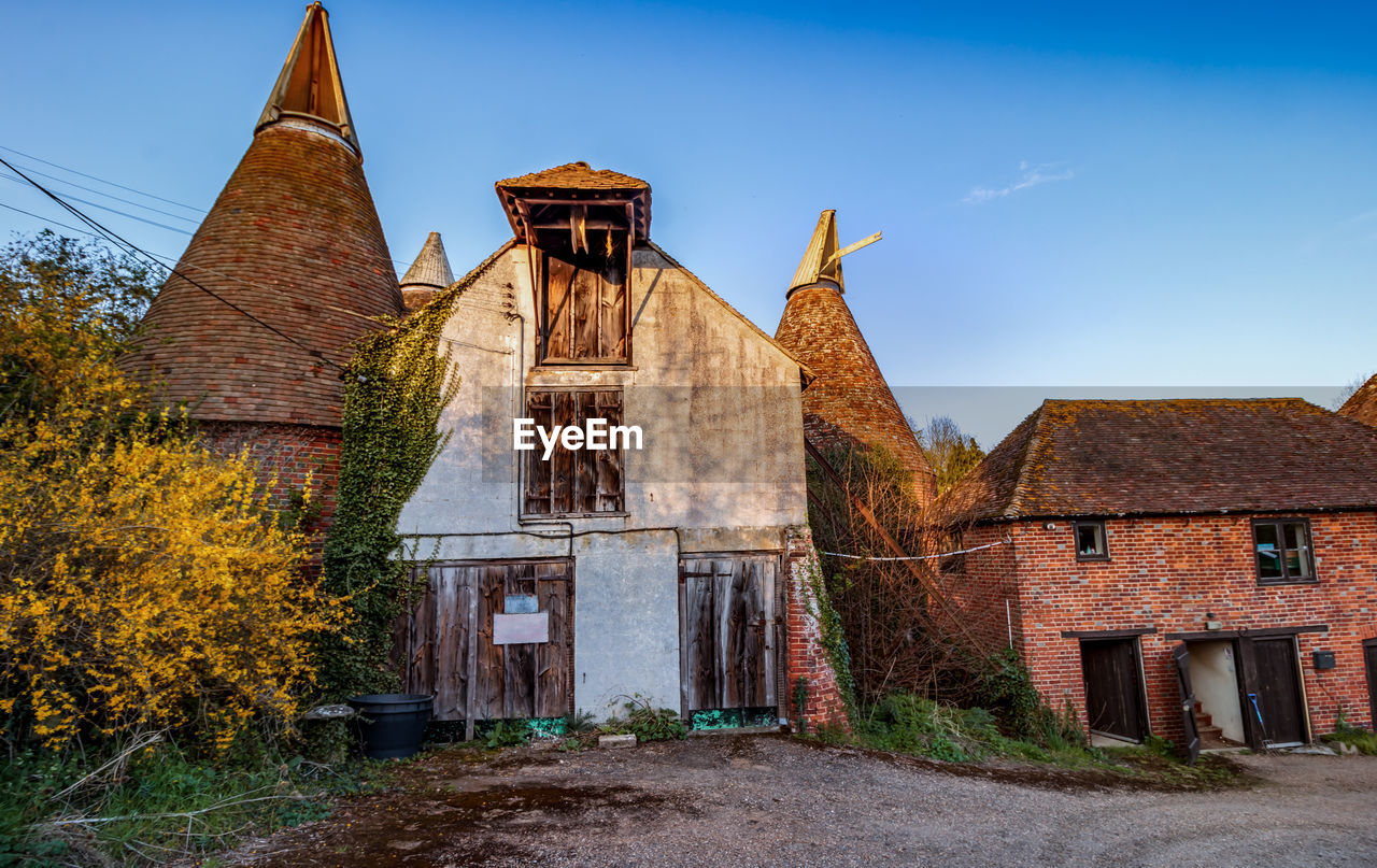 architecture, built structure, building exterior, sky, building, nature, old, plant, no people, day, abandoned, history, tree, the past, religion, place of worship, belief, house, outdoors, deterioration