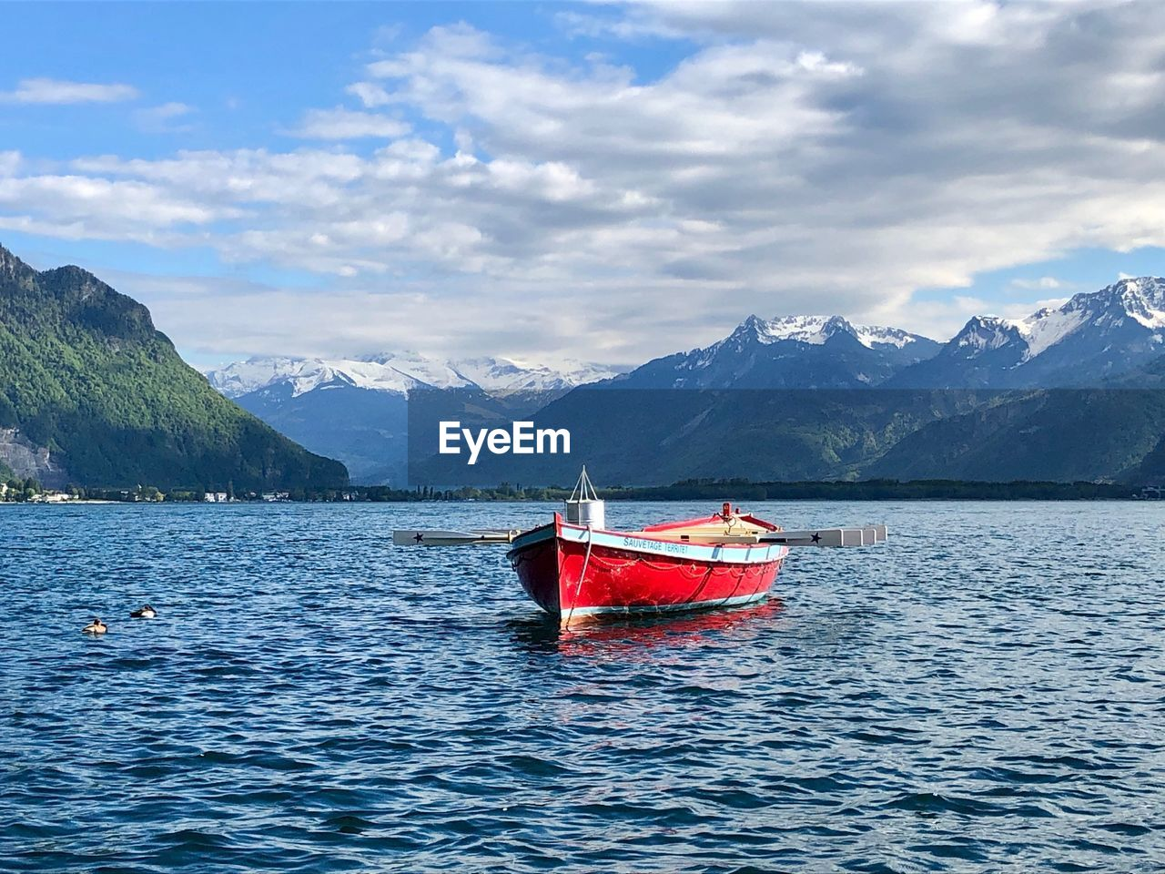 water, mountain, nautical vessel, transportation, cloud - sky, mode of transportation, sky, scenics - nature, beauty in nature, mountain range, waterfront, nature, tranquil scene, tranquility, sea, day, non-urban scene, no people, red, outdoors, snowcapped mountain