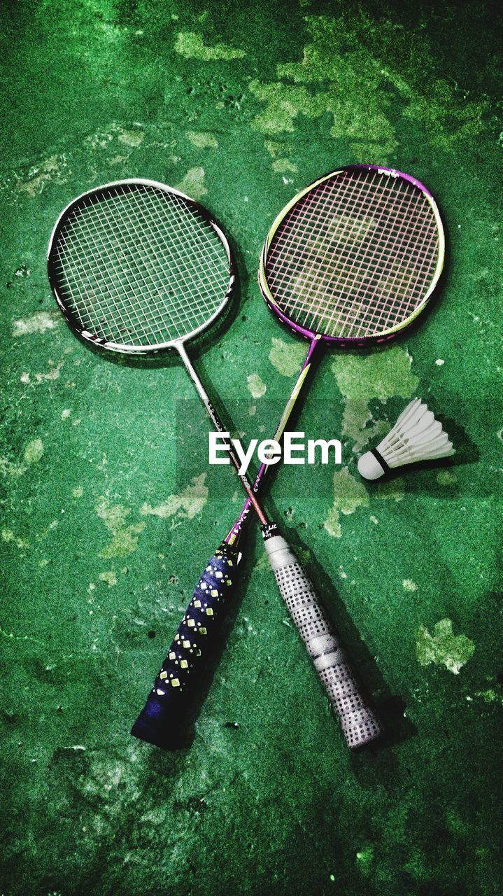 High angle view of badminton rackets with shuttlecock