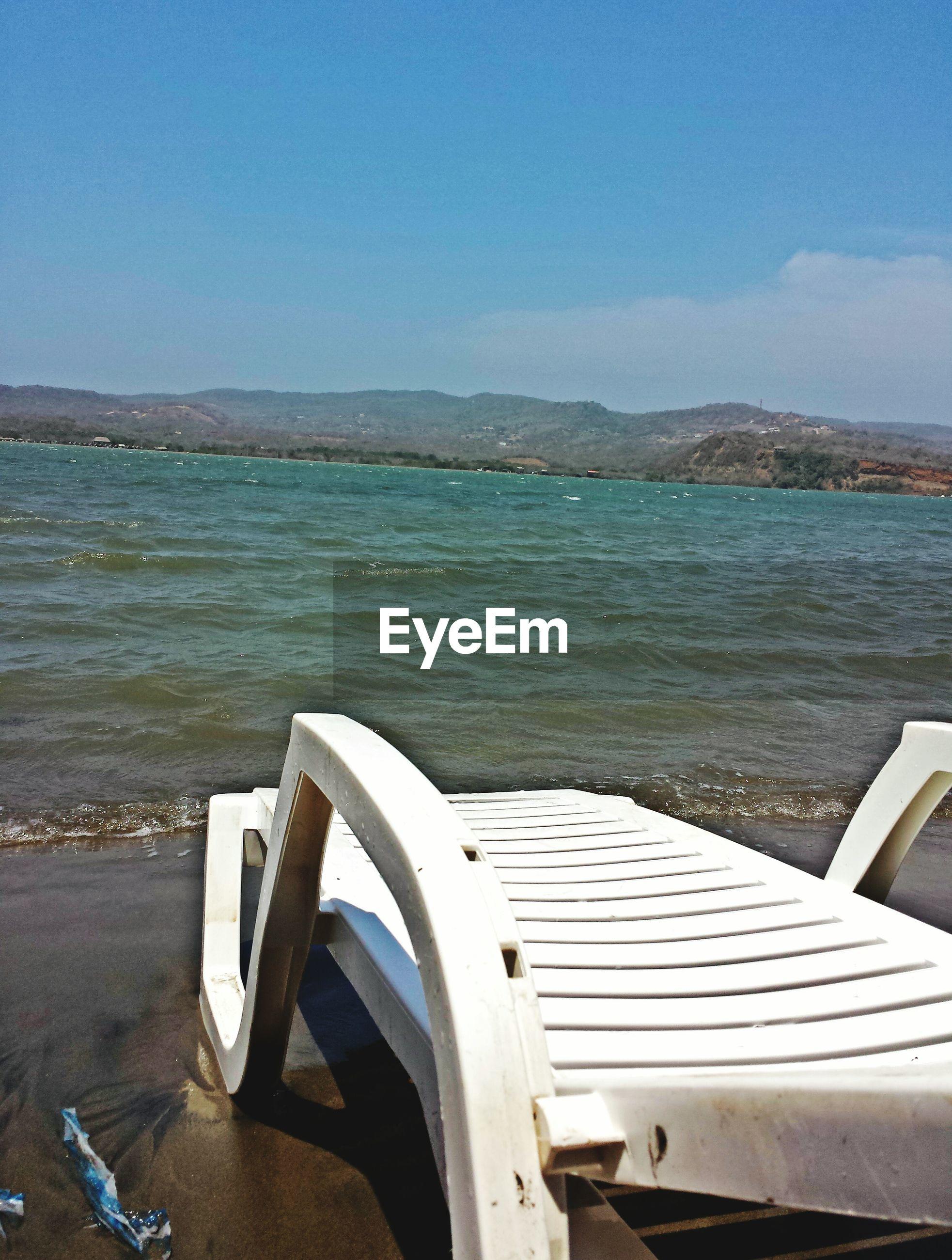 Sun lounger on sea shore