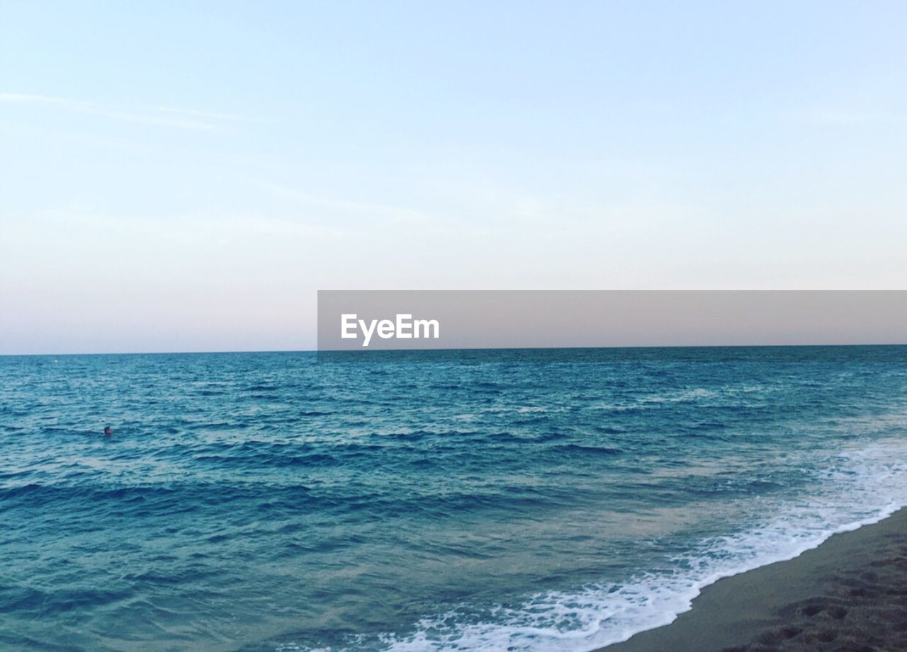 sea, horizon over water, water, scenics, nature, beauty in nature, tranquil scene, tranquility, beach, wave, clear sky, sky, outdoors, day, no people, blue
