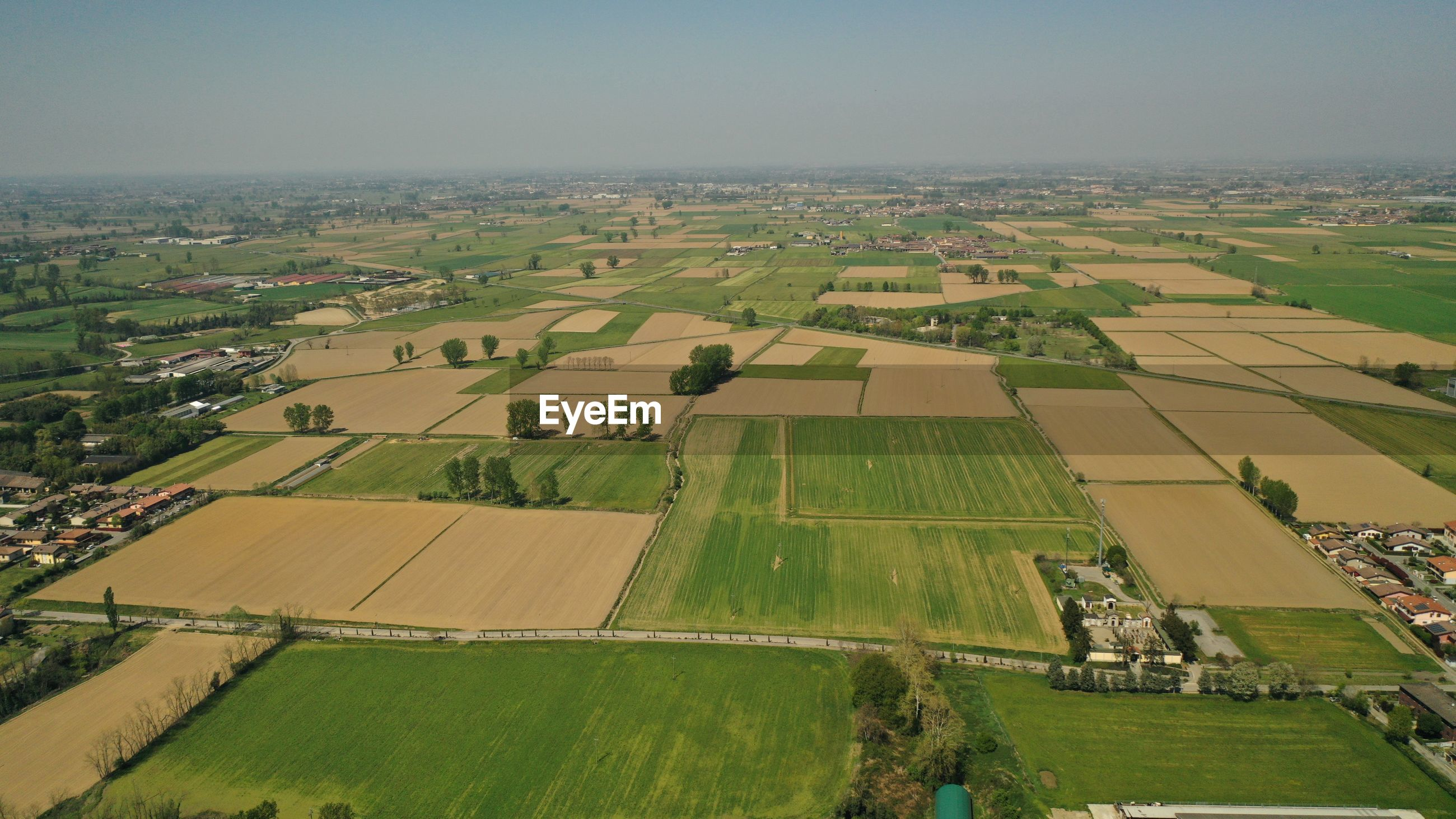 Aerial view of agricultural field against sky
